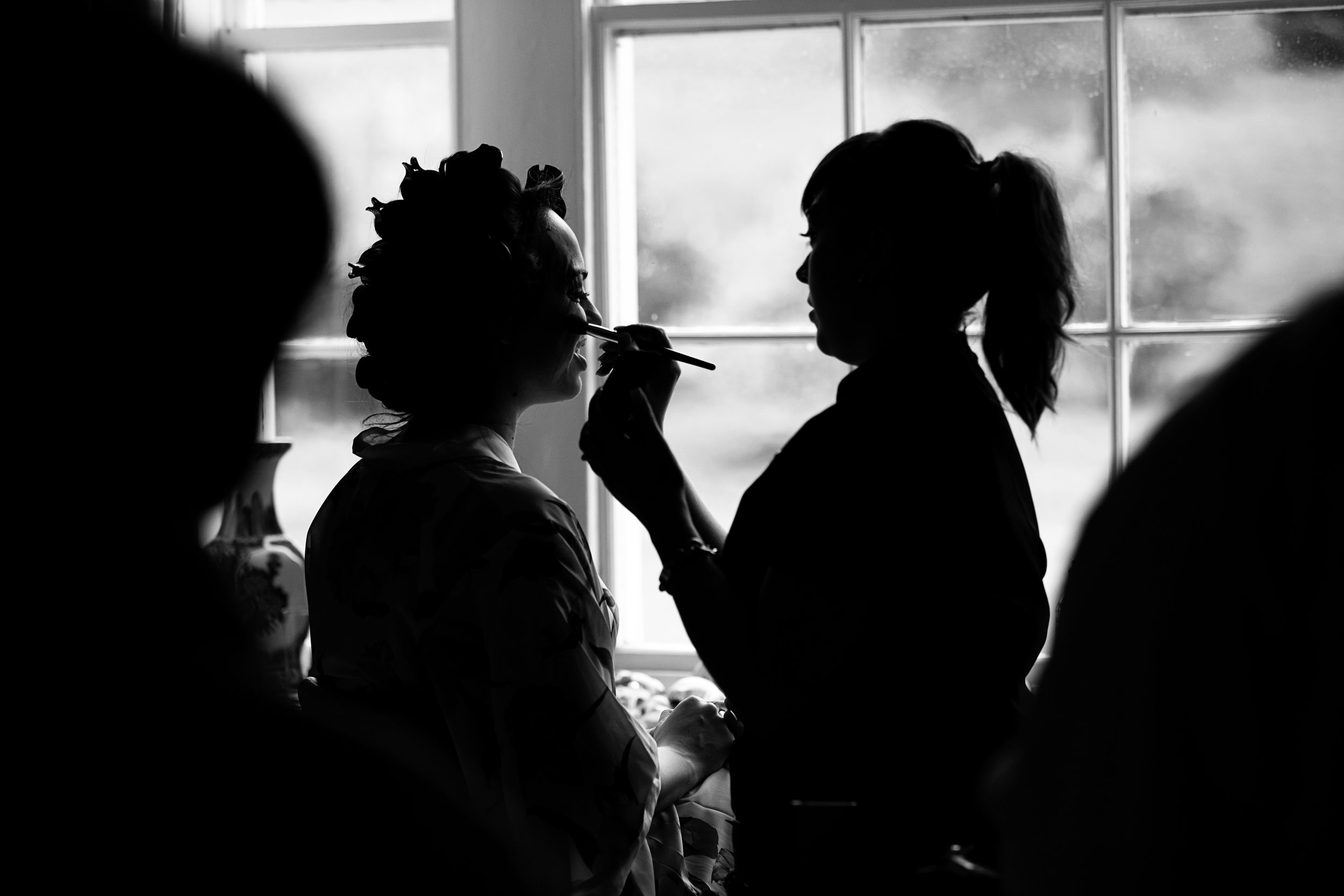 Bride's make up at Braxted Hall, Suffolk wedding