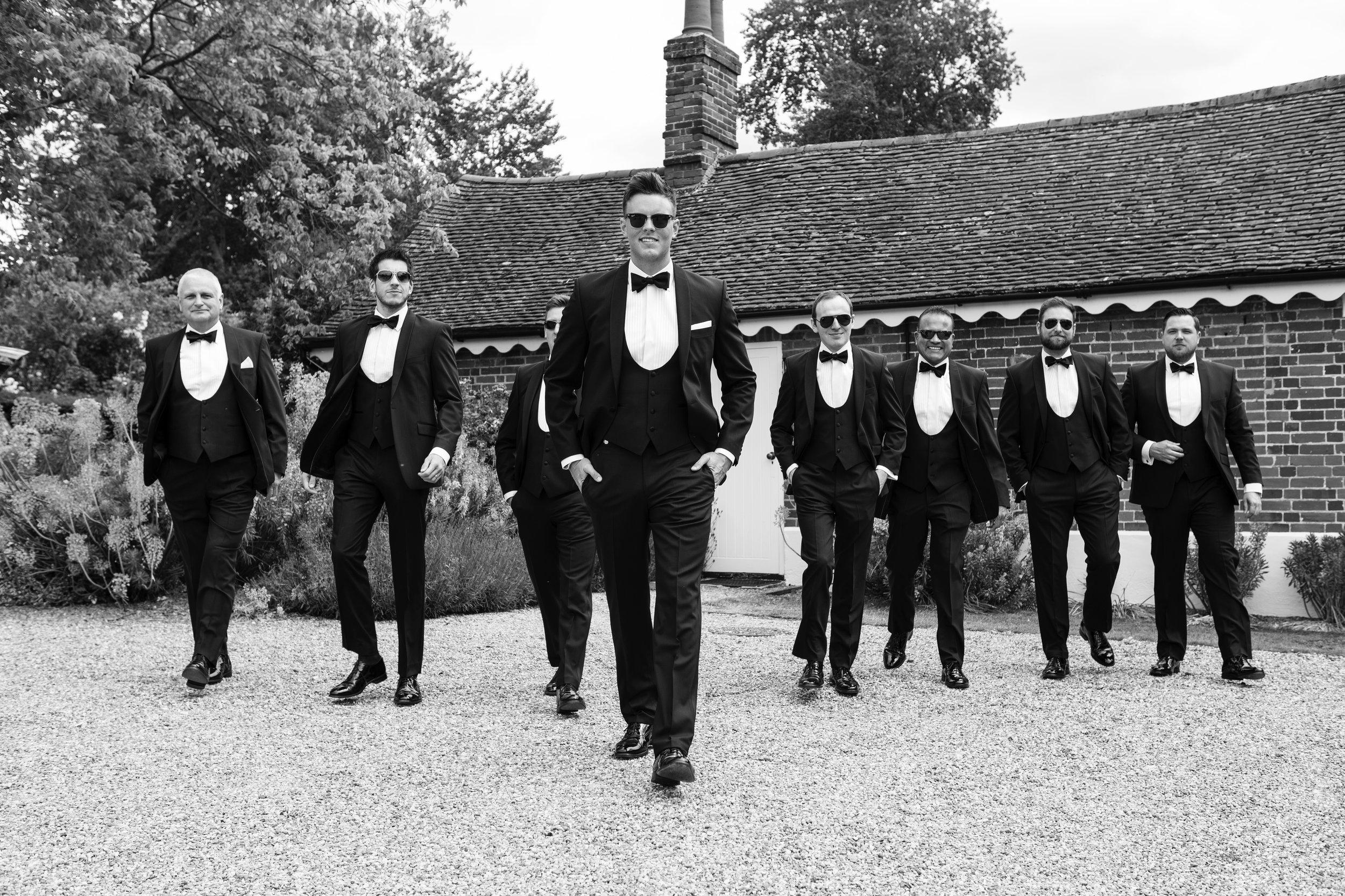 Groom with his groomsmen walking