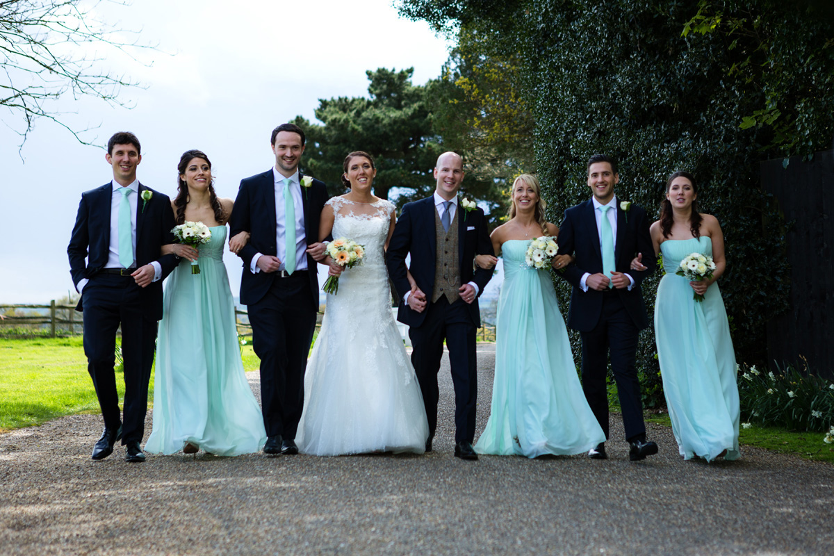 Bride and groom with bridesmaids and groomsmen at Gaynes Park