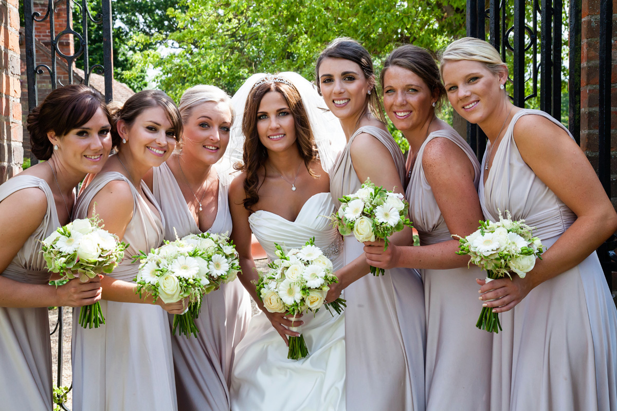 Bride with her bridesmaid at Braxted Park, Essex