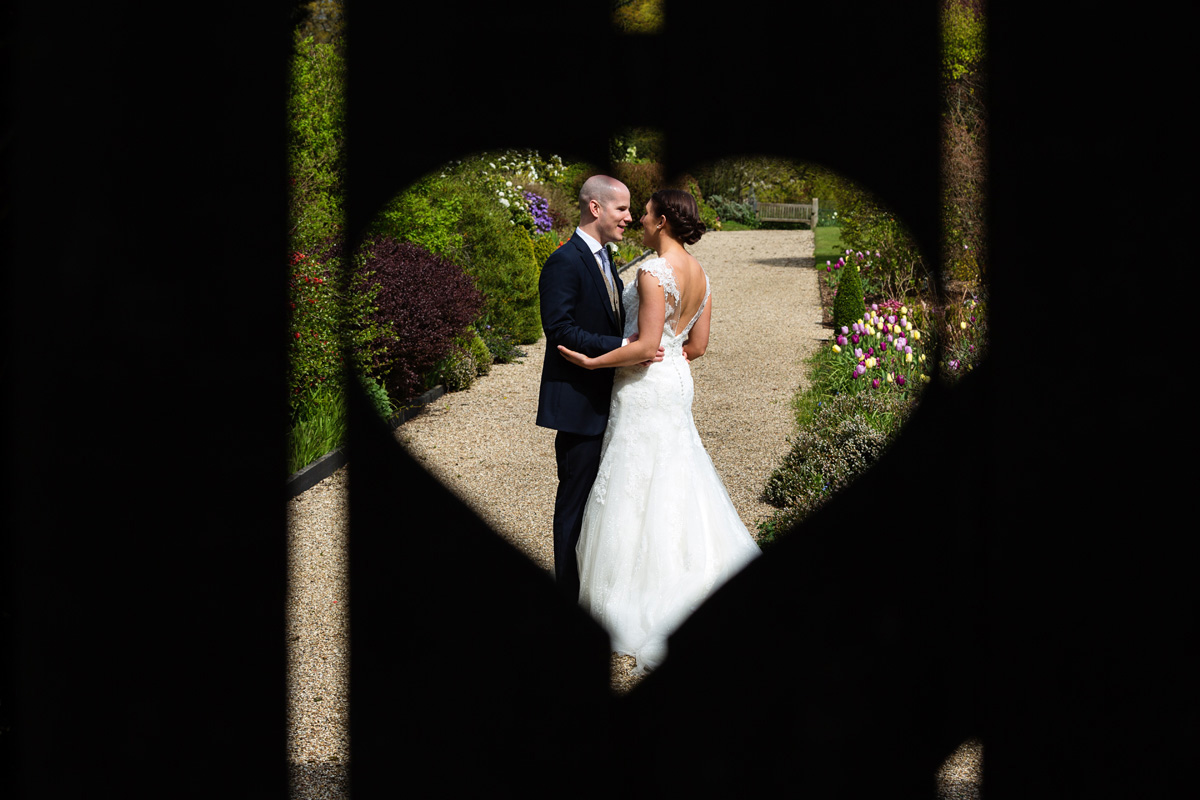 Bride and groom pictured in a heart at Gaynes Park