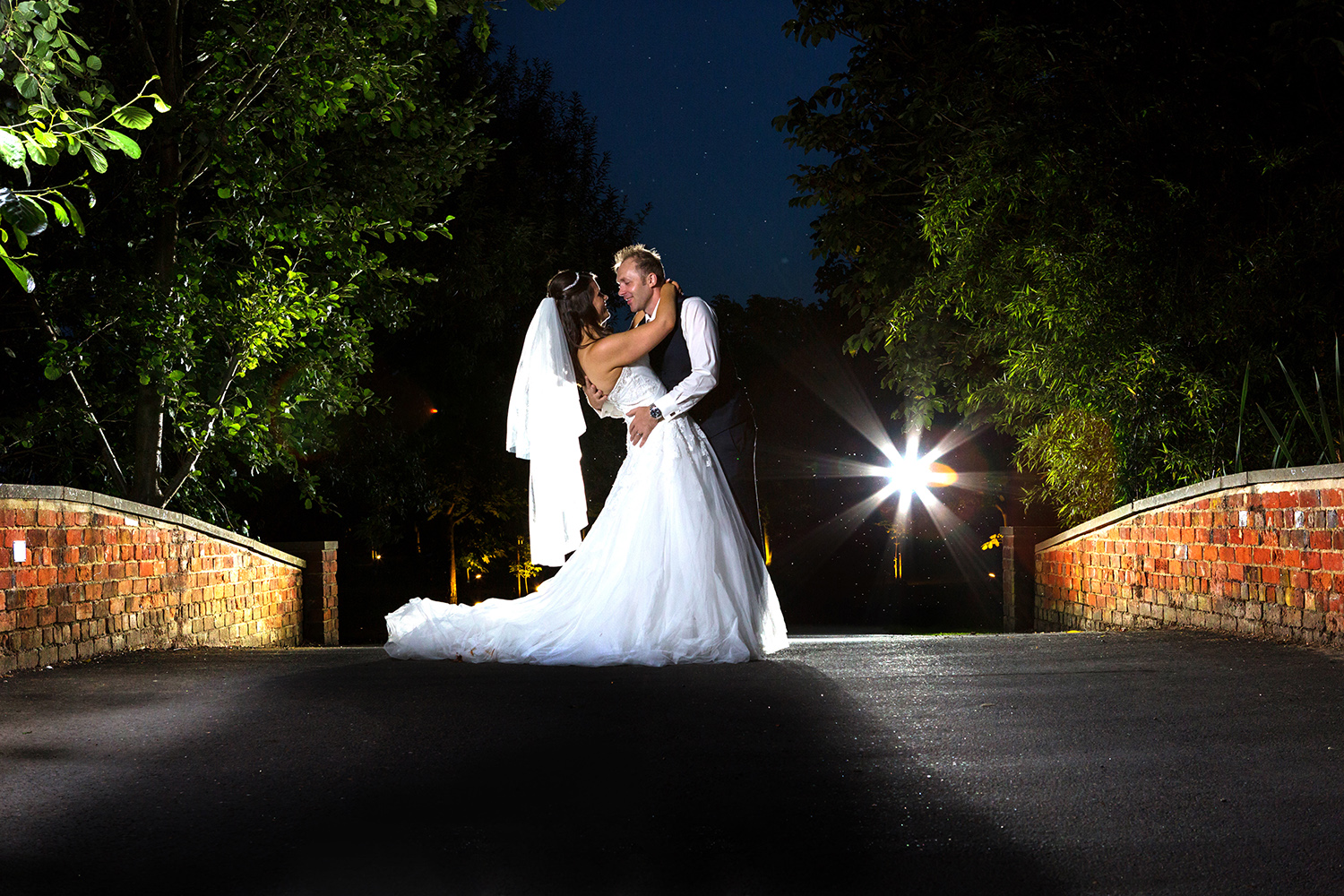 Bride and groom portrait using three lights at their Suffolk wedding