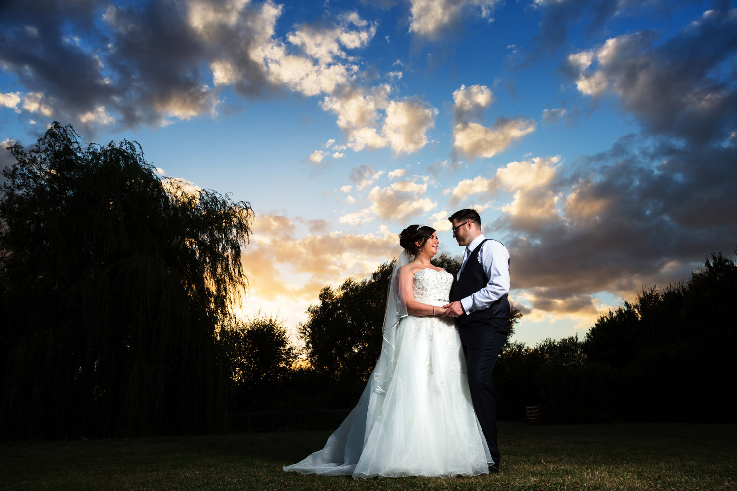 Bride and groom with a clearing evening sky over Pitsea Essex