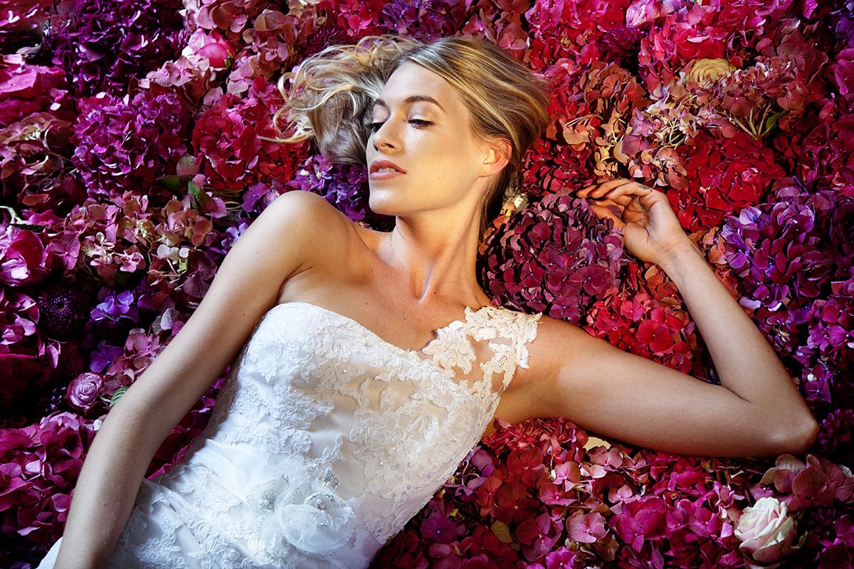 Bride with floral backdrop