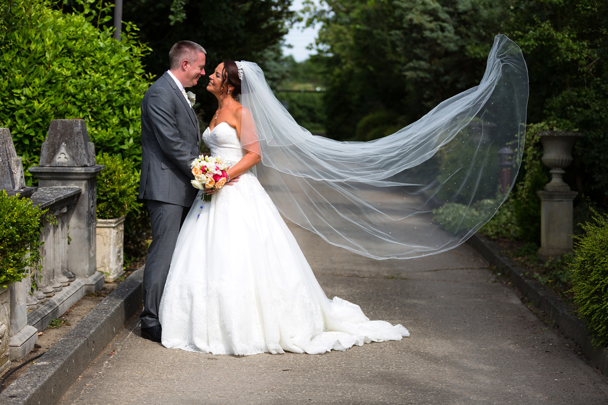 The bride's flowing veil at her Essex wedding