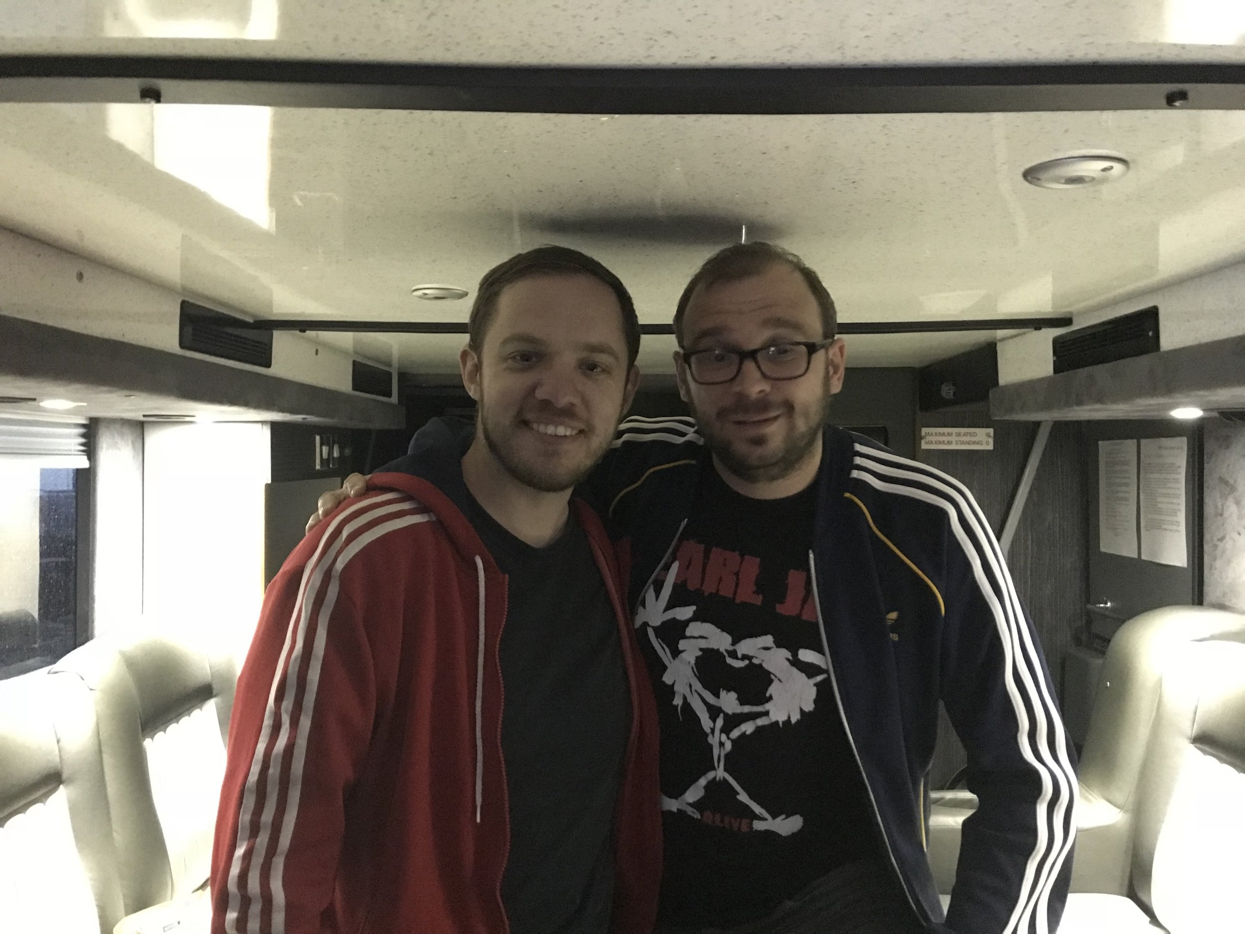 Ben re-living the 90's with Jon in their finest Adidas gear as he draws one all with me on tour bus appearances.