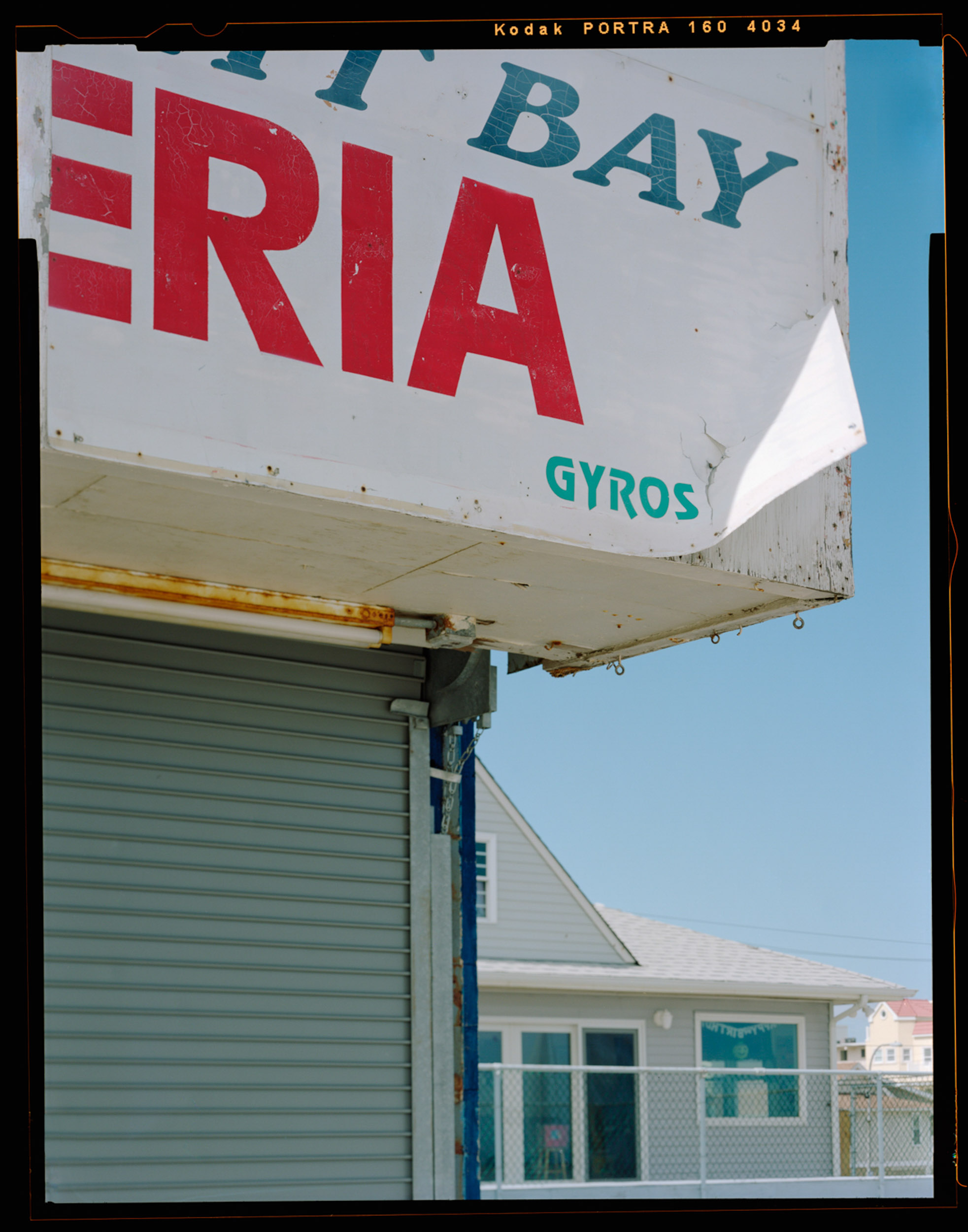 Gyros, Seaside, NJ. 2014. 4x5 Negative Shen-Hao.    This capture simply shows the work that lies ahead. This photo gives a more detailed perspective of the destruction. I also loved the light on the sign which was casted from the sun.