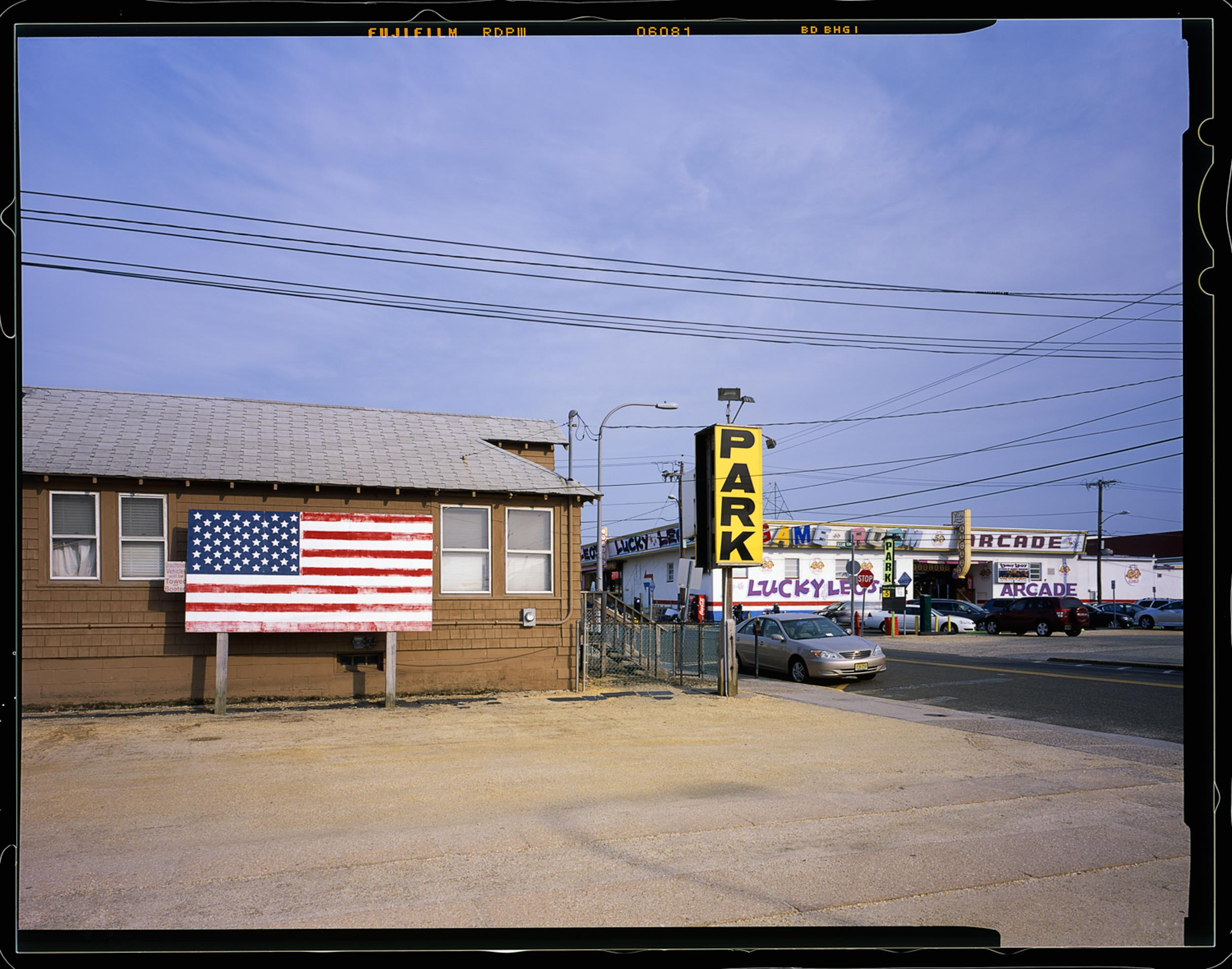 Park, Seaside, NJ 2014 4x5 Shen Hao.    Parked here one day and saw this cool view of the back of the boardwalk with this giant American flag.