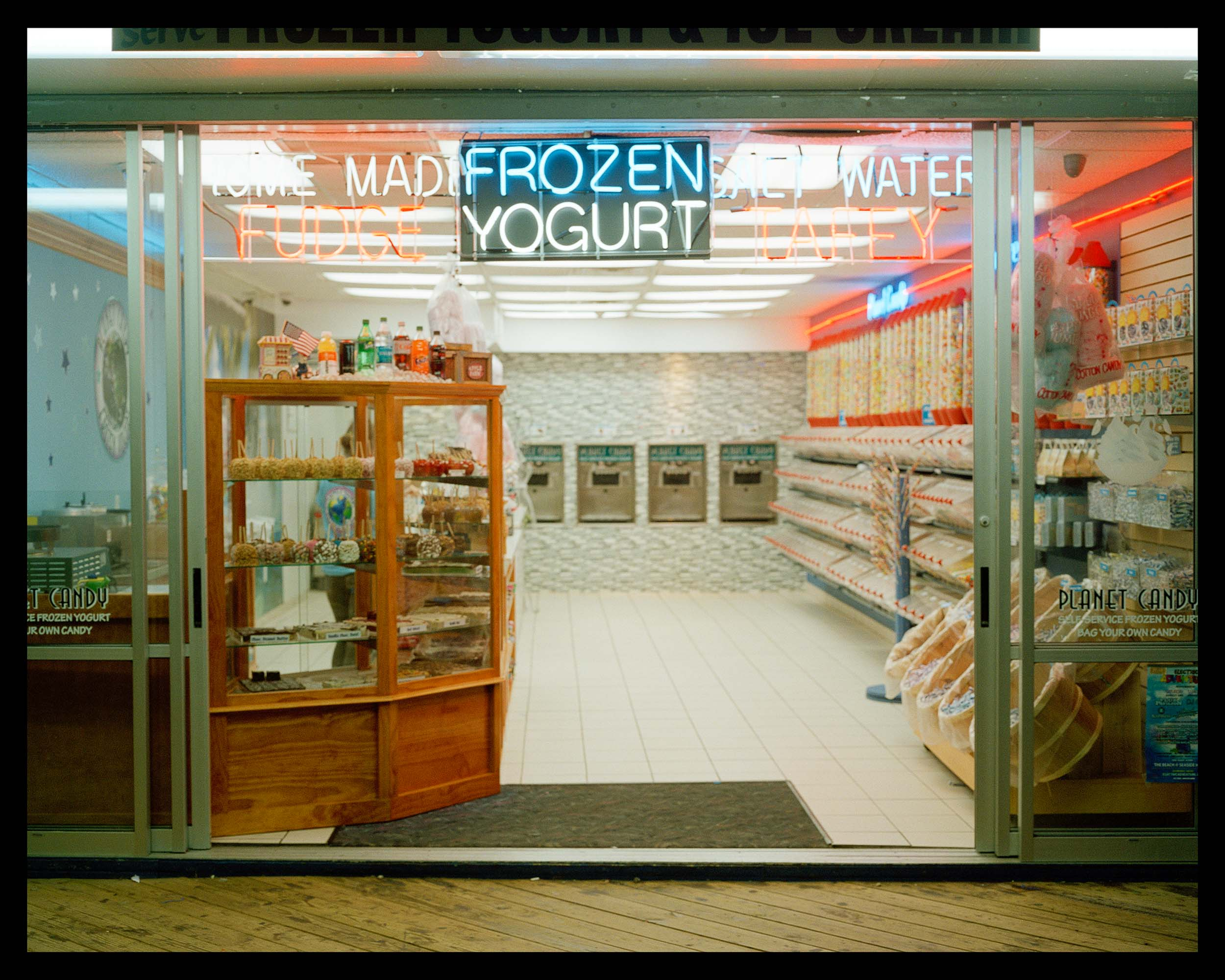 Frozen Yogurt, Seaside, NJ. 2015. Bronica ETRS.    A little salt water taffy, candy apples, and frozen yogurt stand late night on the boardwalk.