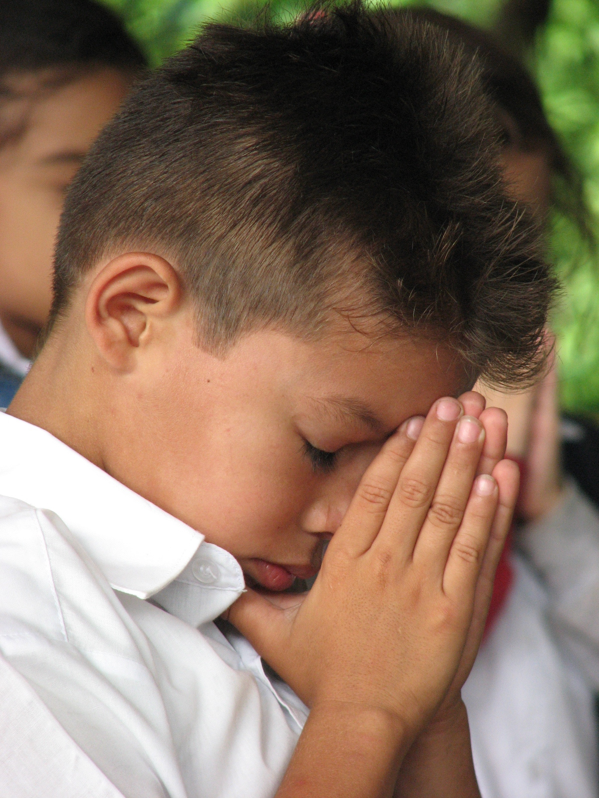 Boy praying photo.JPG