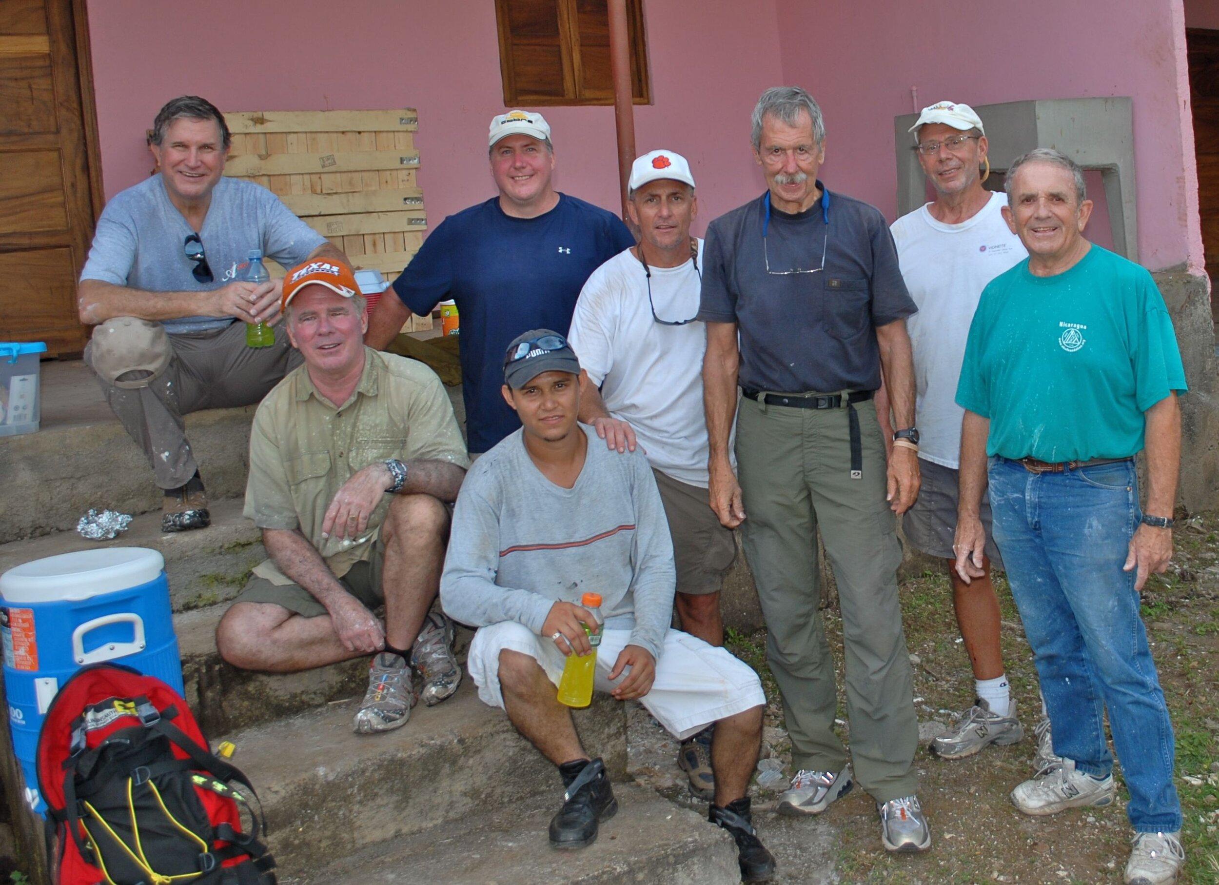 john and group of men working.jpg