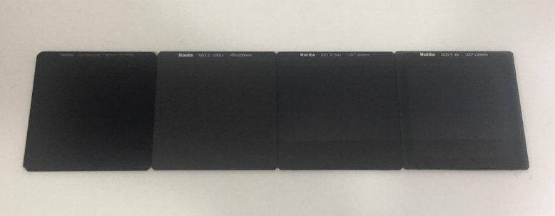 Comparison between Haida neutral density filters. (From left to right) Haida 15 stop neutral density filter, Haida 10 stop neutral density filter, Haida 6 stop neutral density filter, Haida 3 stop neutral density filter.