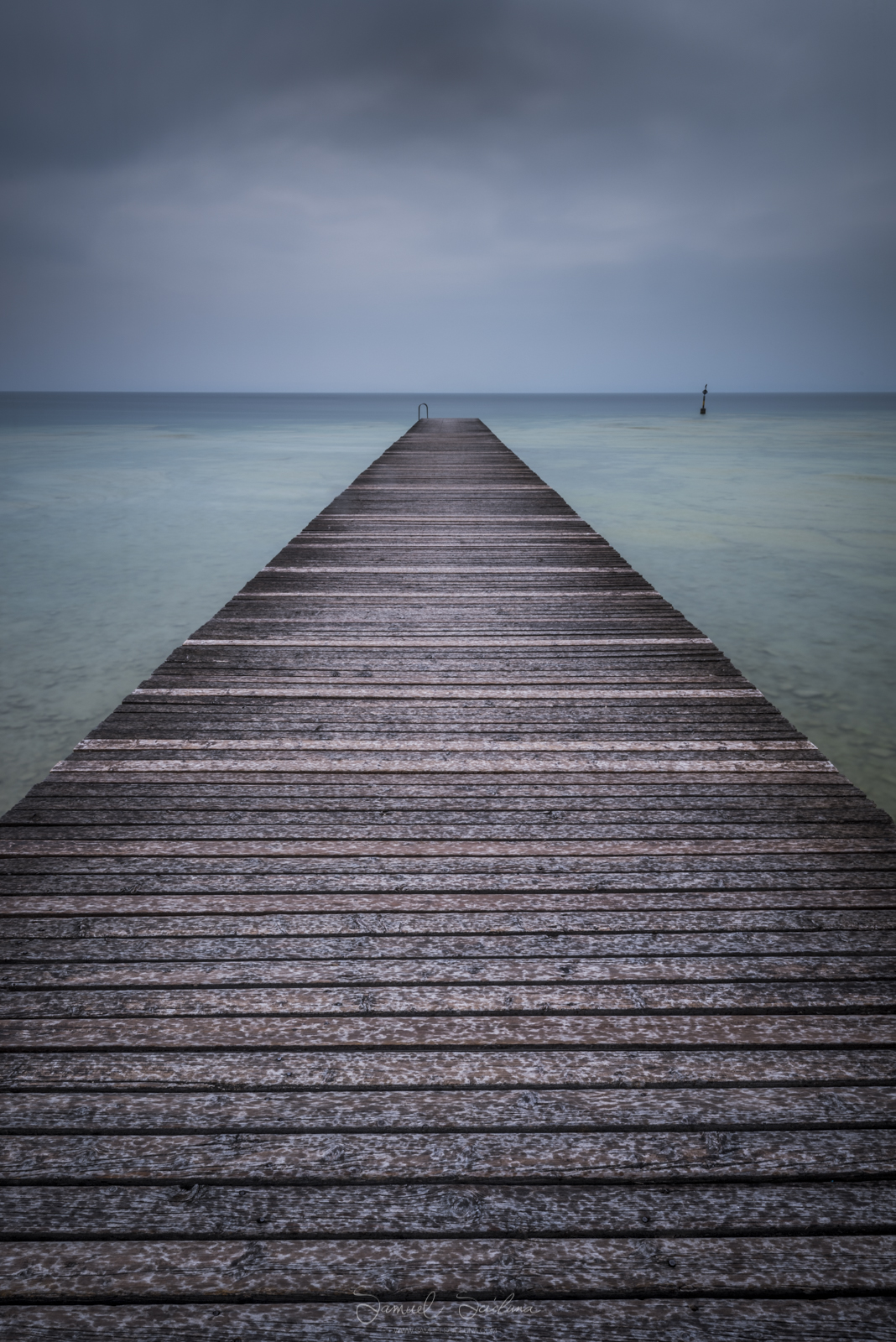 4 minute exposure of a pier in Lago di Garda using a Haida 10 stop neutral density filter.