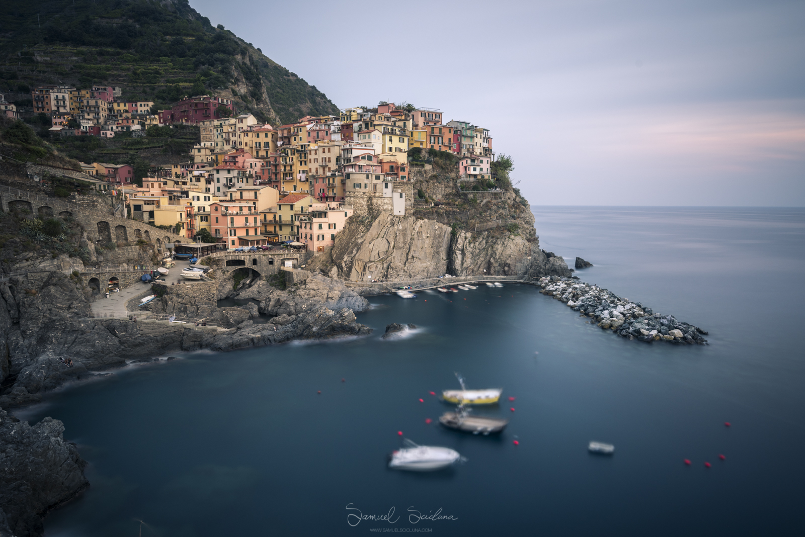 An 8 minute exposure of Manarola at sunset using a Haida Pro 100 filter holder and Haida 10 stop neutral density filter.