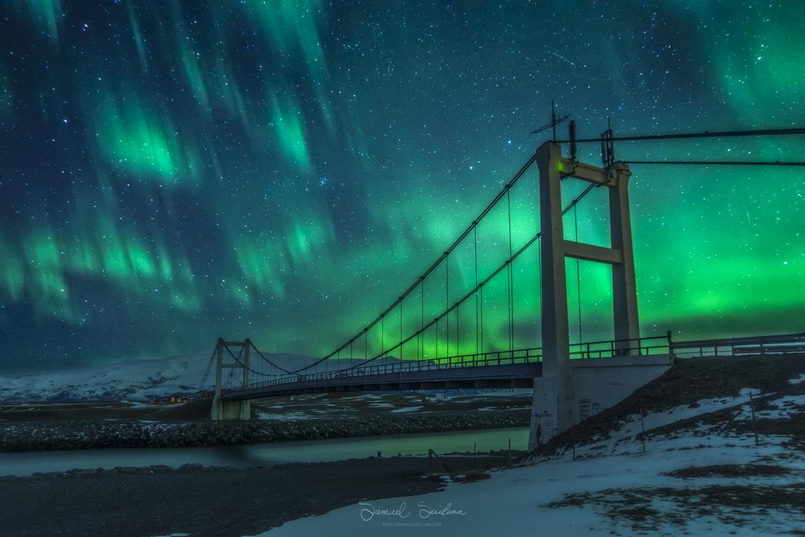 An explosion of Auroral activity above the famous suspension bridge at Jökulsárlón glacier lagoon.