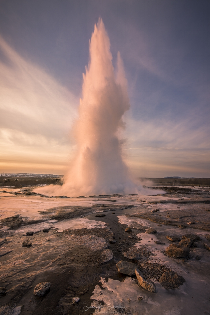 The first light after sunrise hits the epic Strokkur geysir, as it shoots steam upto 20 meters high!