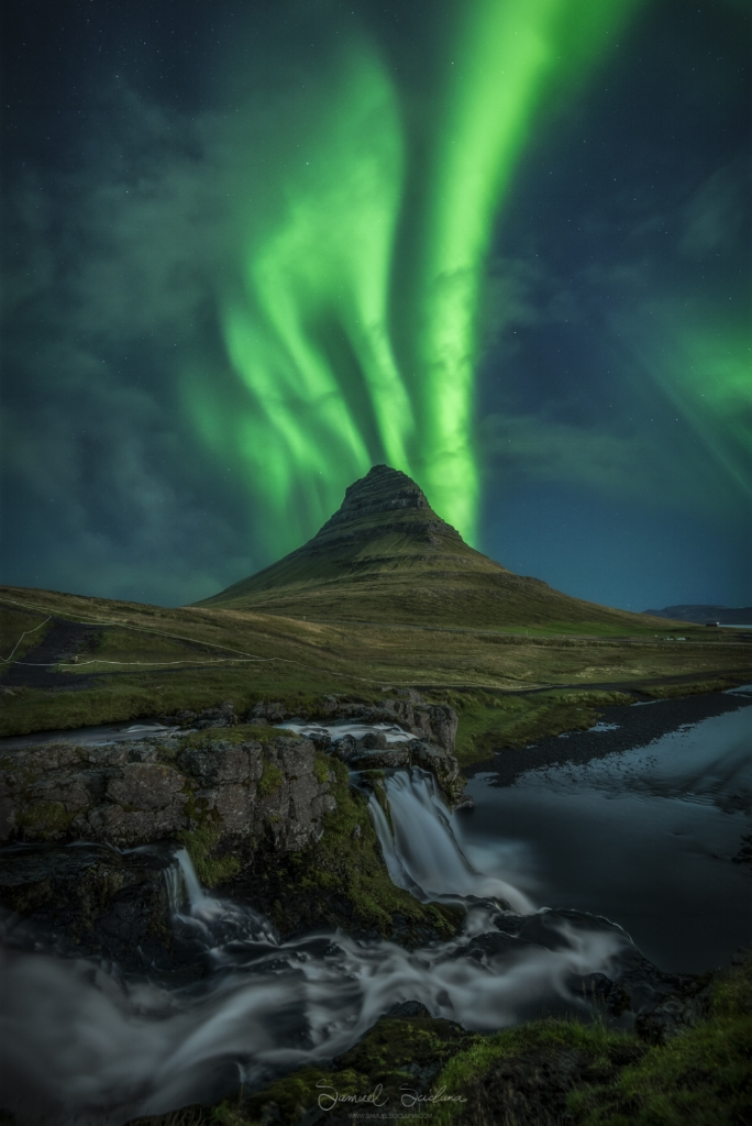 Kirkjufell mountain in Iceland with awesome ribbons of the Northern Lights behind it during a KP5 (G1) geomagnetic storm.