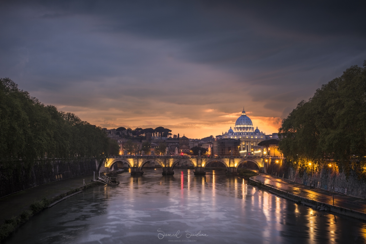 A classic view. The Vatican is visible from a bridge crossing the river Tiber.