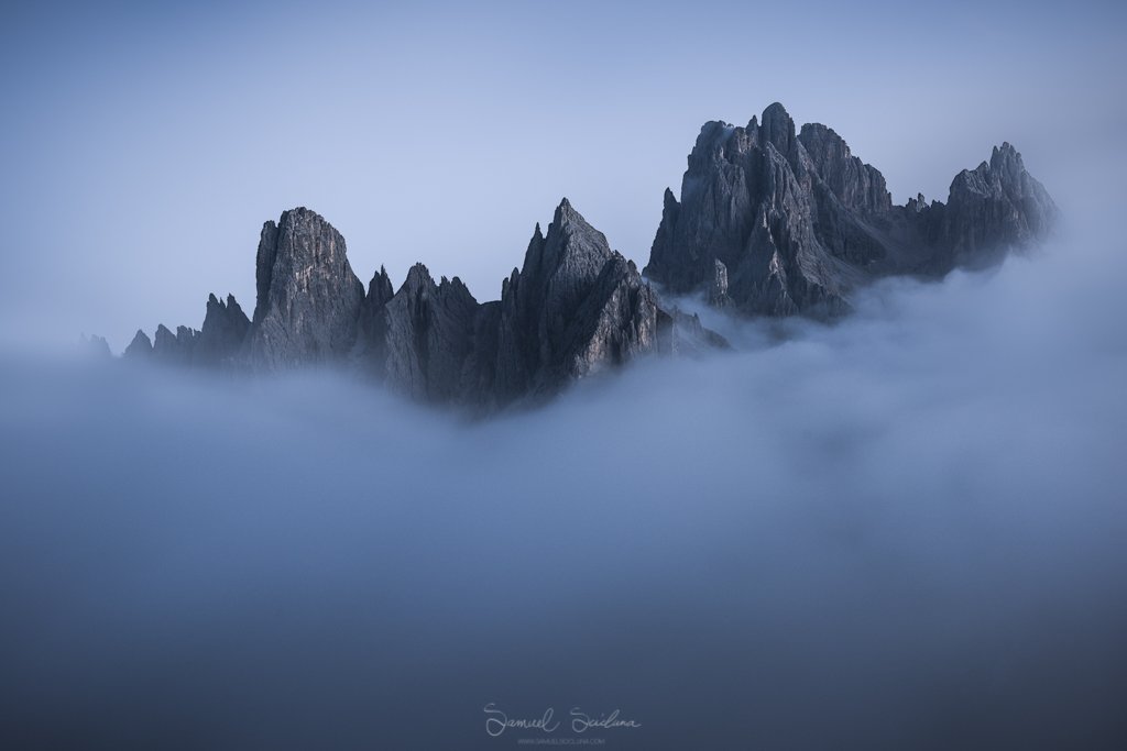 The Cadini di Misurina peaking through the low clouds.