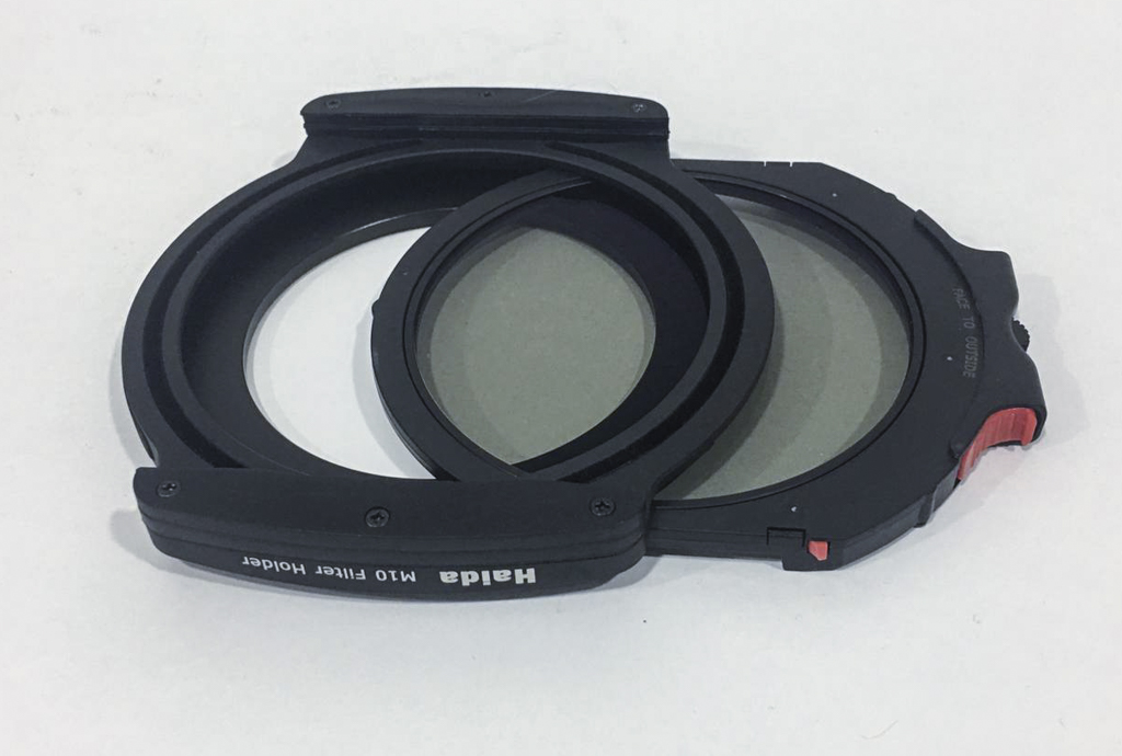 The M10 holder with the Drop In circular polarizer half-inserted.