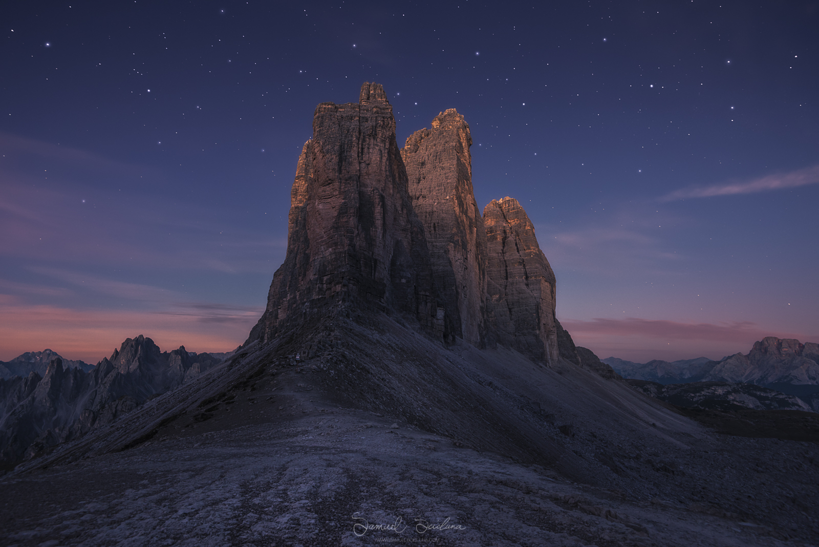 Alpen glow hitting the Tre Cime before sunrise as the stars fade into the dawn.