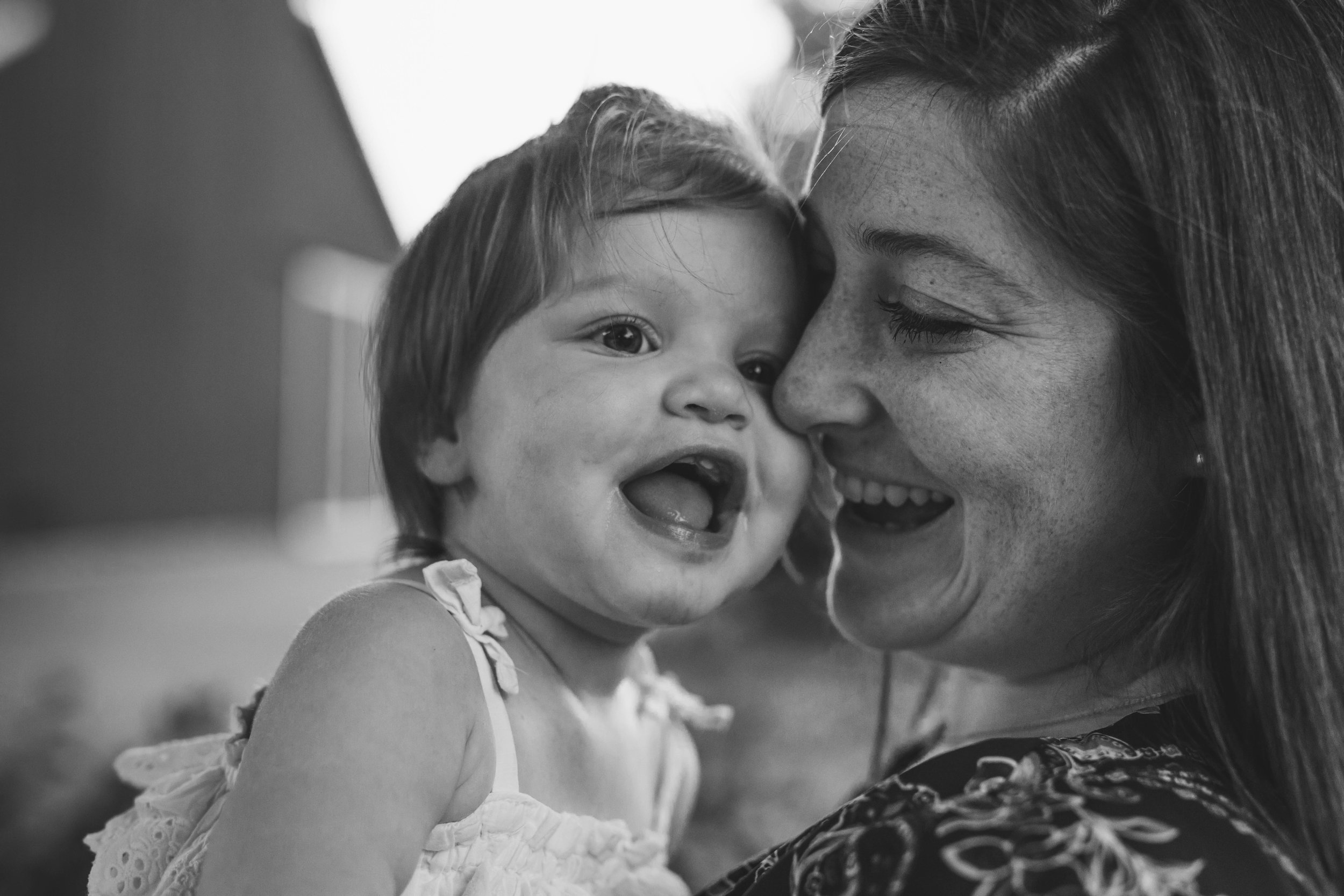 Playful and sweet family session in Issaquah at golden hour and twilight Mom and Dad with their toddler photographed by Chelsea Macor Photography in a playful and intimate way-26.jpg