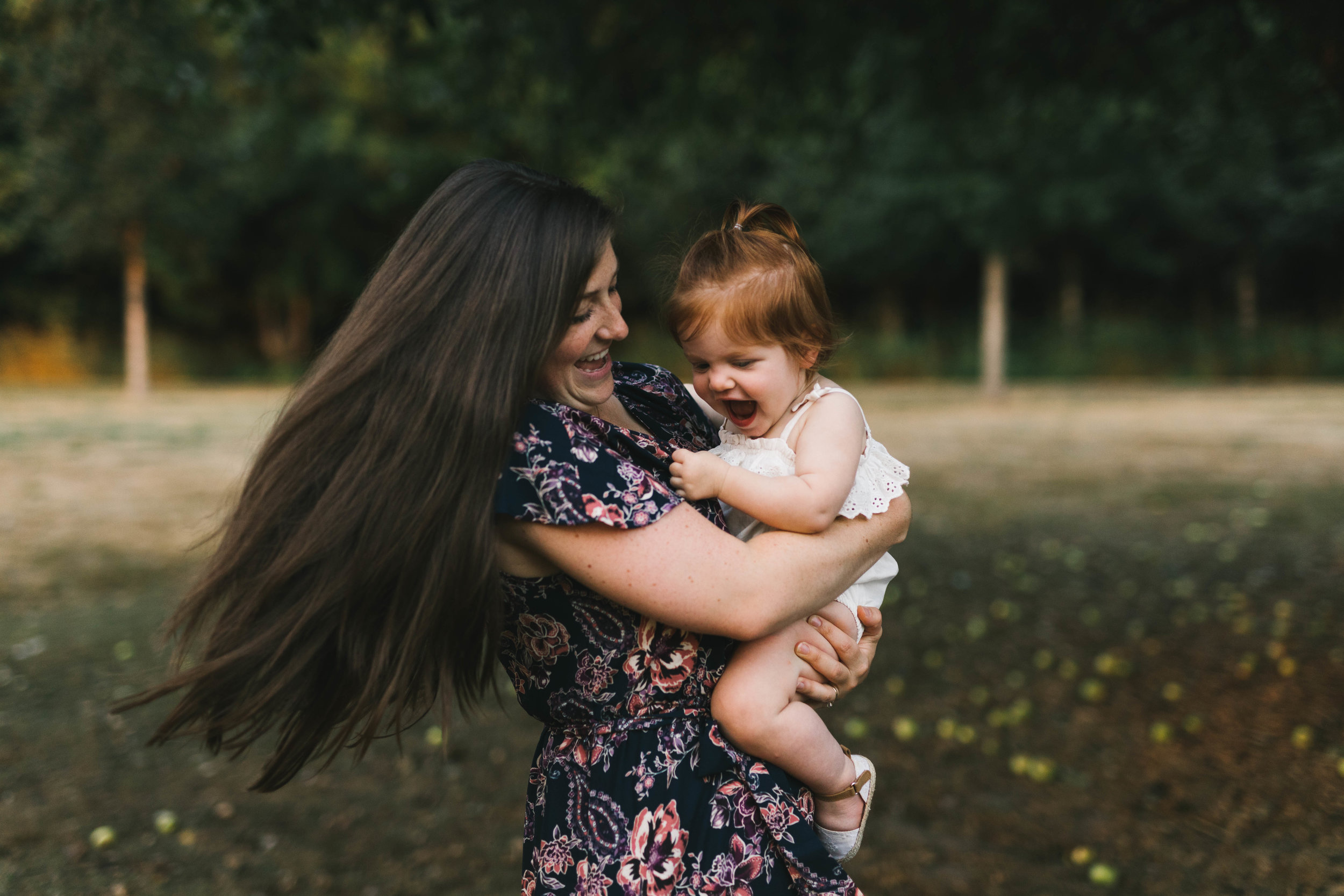 Playful and sweet family session in Issaquah at golden hour and twilight Mom and Dad with their toddler photographed by Chelsea Macor Photography in a playful and intimate way-7.jpg
