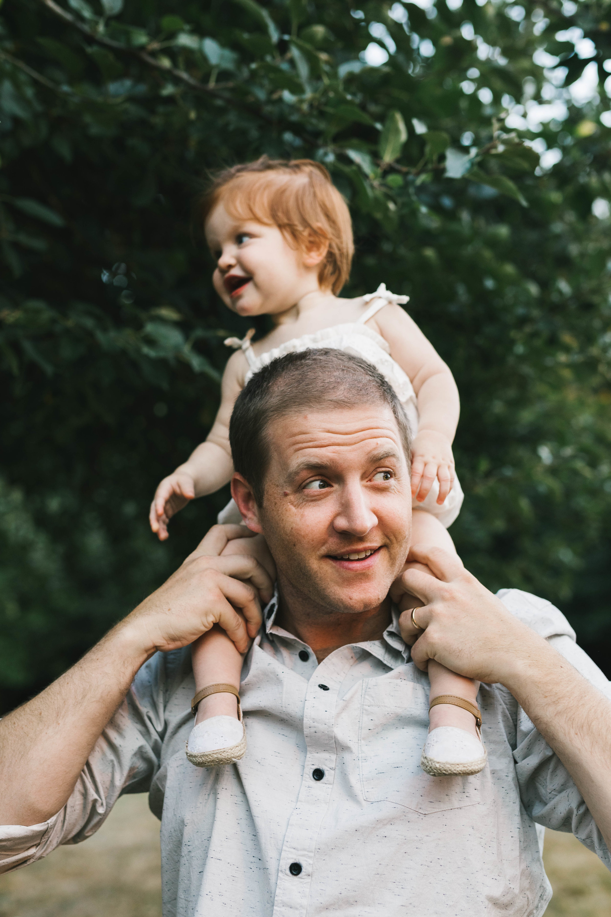 Playful and sweet family session in Issaquah at golden hour and twilight Mom and Dad with their toddler photographed by Chelsea Macor Photography in a playful and intimate way-9.jpg