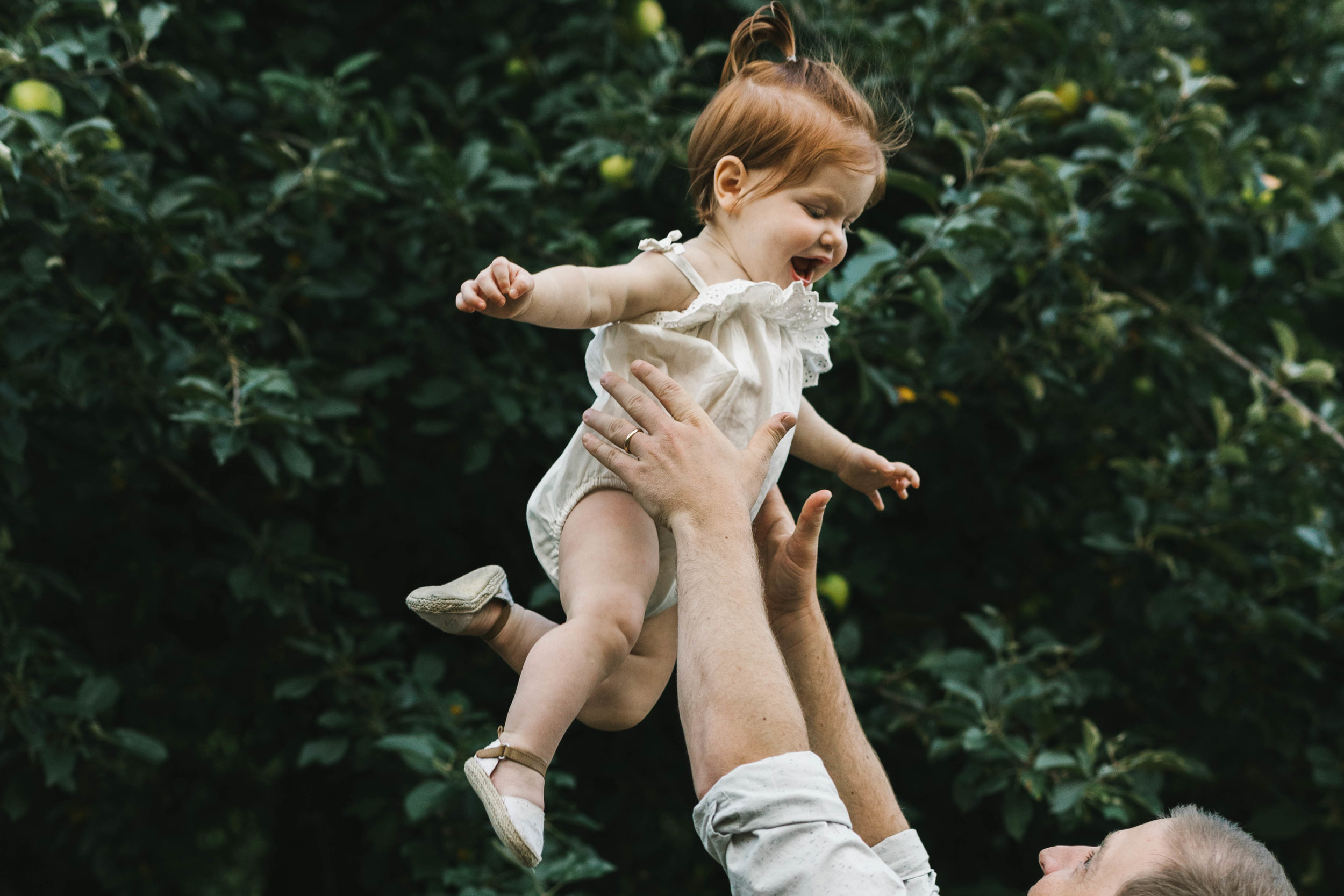 Playful and sweet family session in Issaquah at golden hour and twilight Mom and Dad with their toddler photographed by Chelsea Macor Photography in a playful and intimate way-16.jpg
