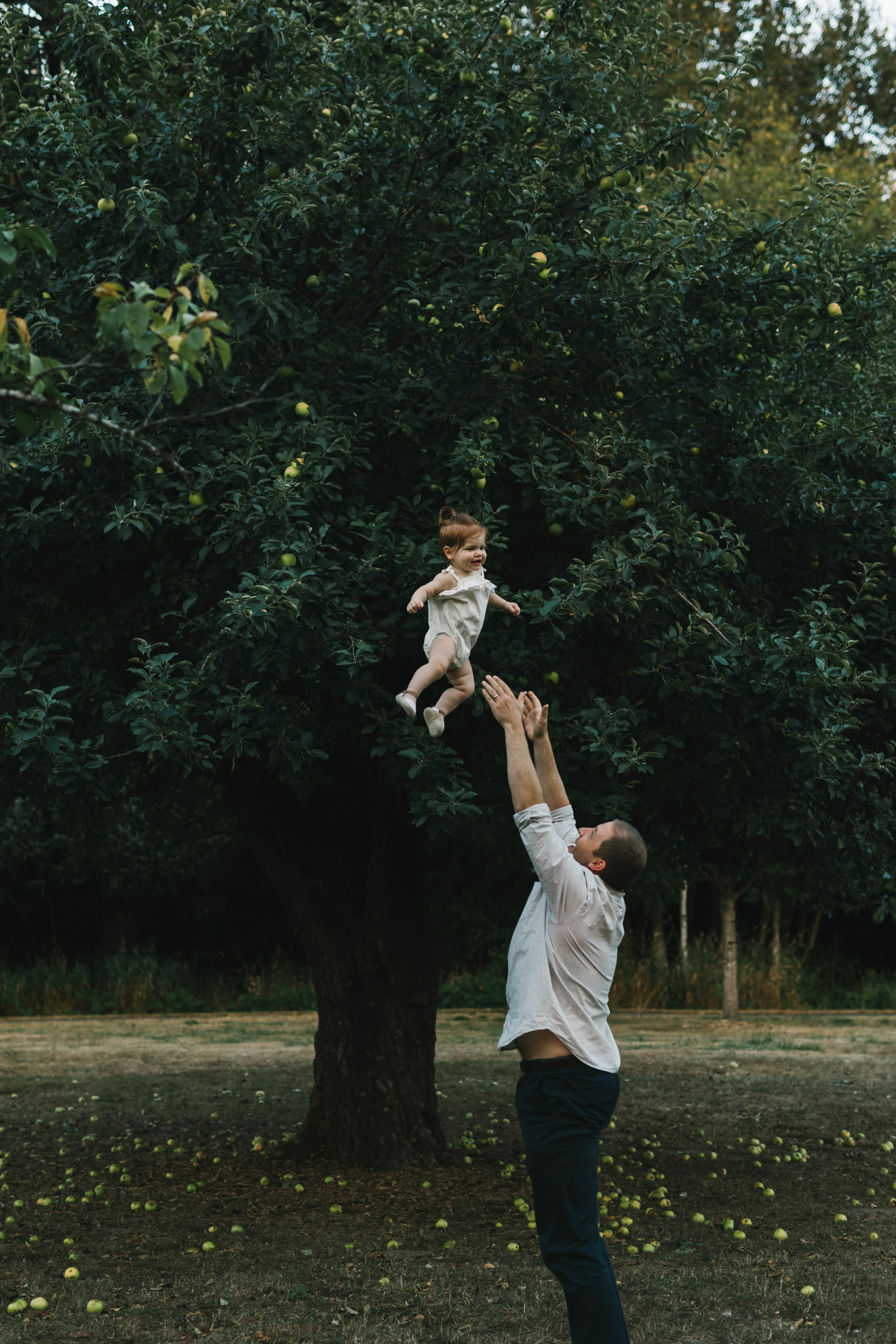 Playful and sweet family session in Issaquah at golden hour and twilight Mom and Dad with their toddler photographed by Chelsea Macor Photography in a playful and intimate way-18.jpg