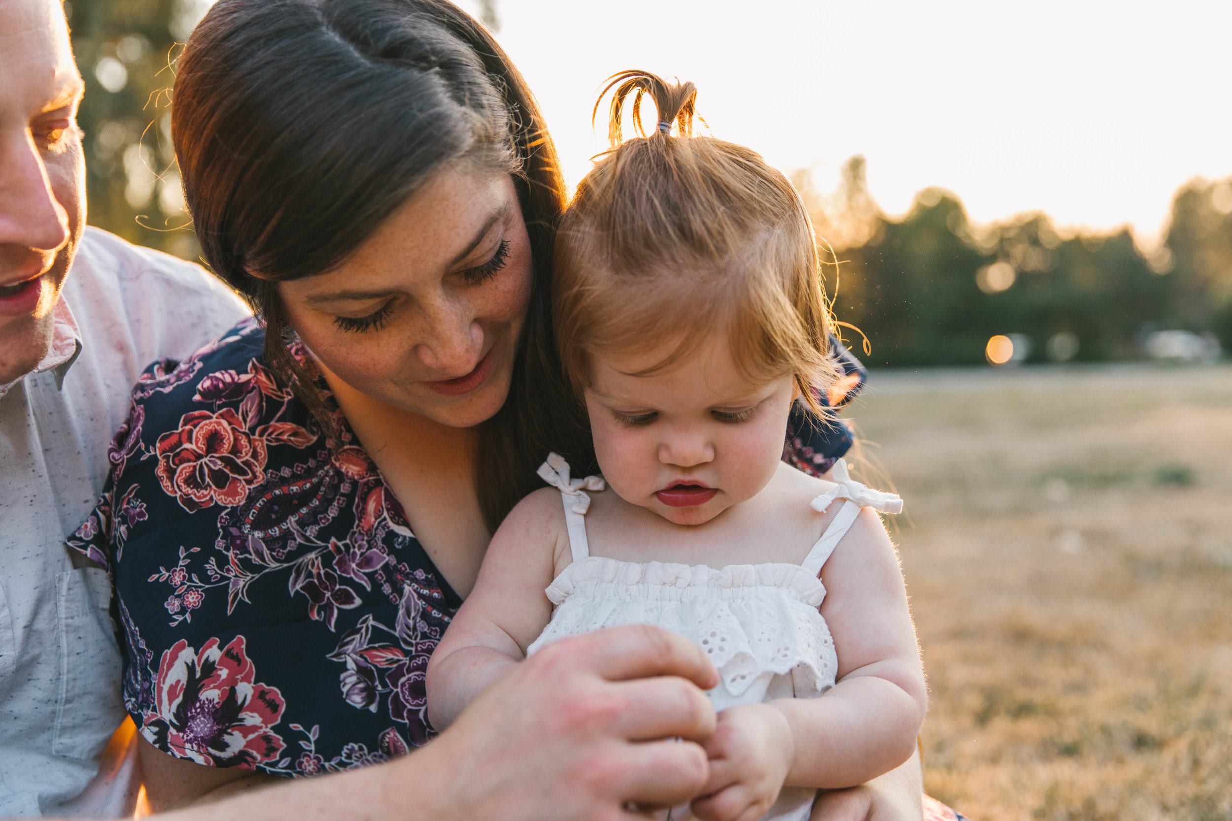 Playful and sweet family session in Issaquah at golden hour and twilight Mom and Dad with their toddler photographed by Chelsea Macor Photography in a playful and intimate way.jpg