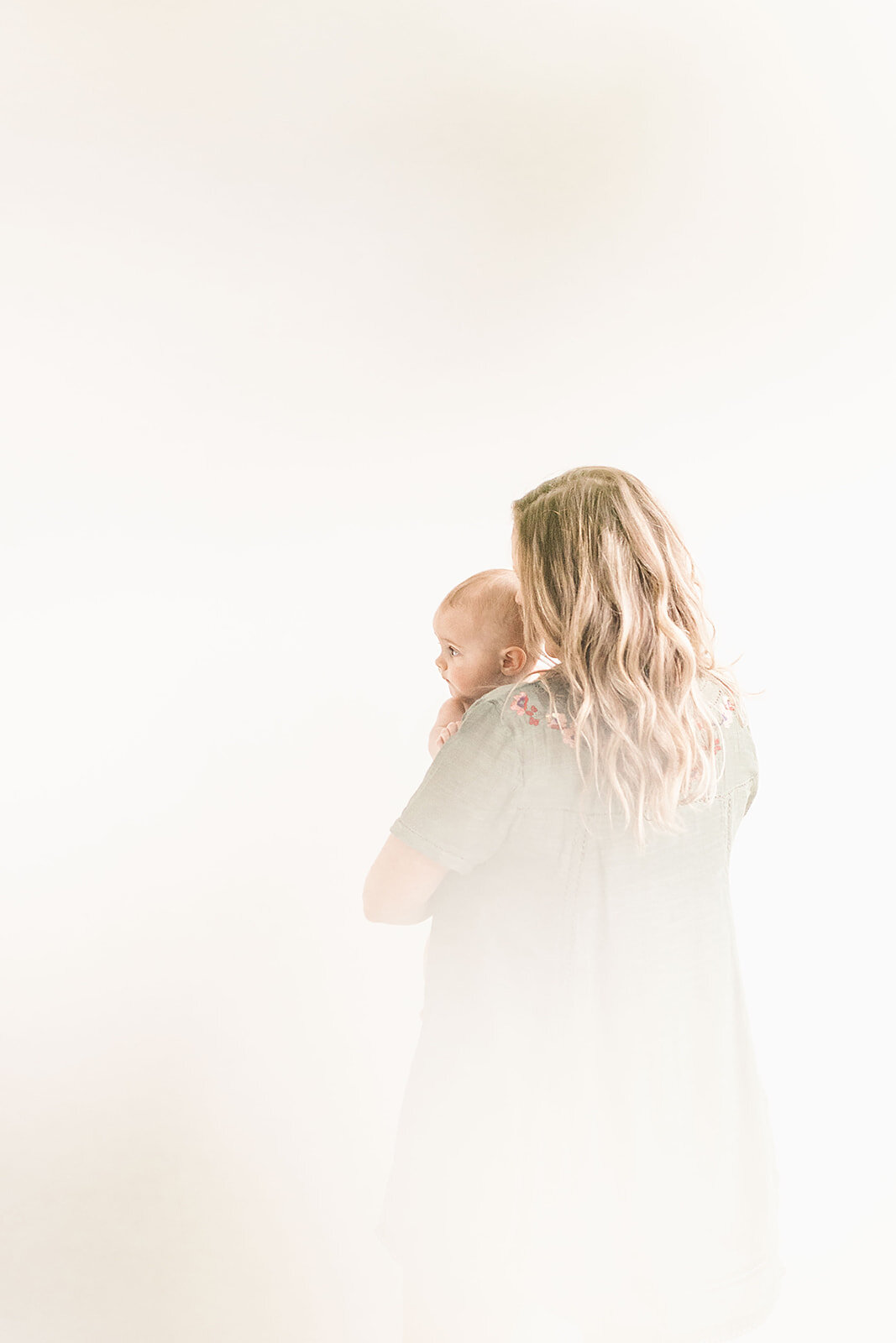 Mother_and_child_captured_in_a_natural_light_Seattle_studio_photographed_by_Chelsea_Macor_Photography-5.jpg