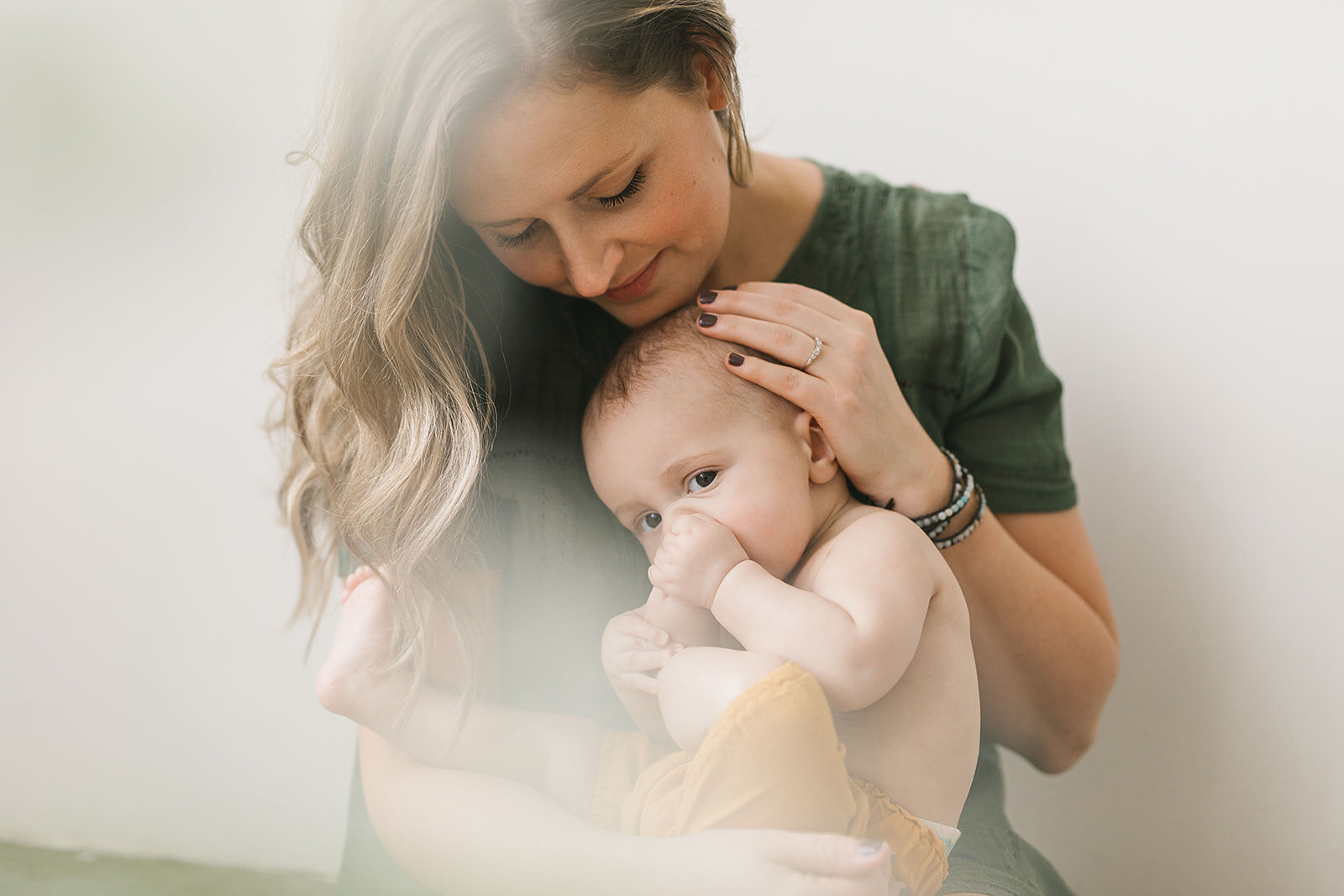 Mother_and_child_captured_in_a_natural_light_Seattle_studio_photographed_by_Chelsea_Macor_Photography-16.jpg