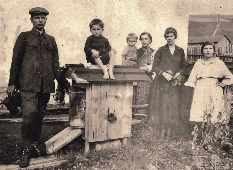 My grandad Kazimierz (sitting on the bee hive) as a child in Poland, surrounded by his family.