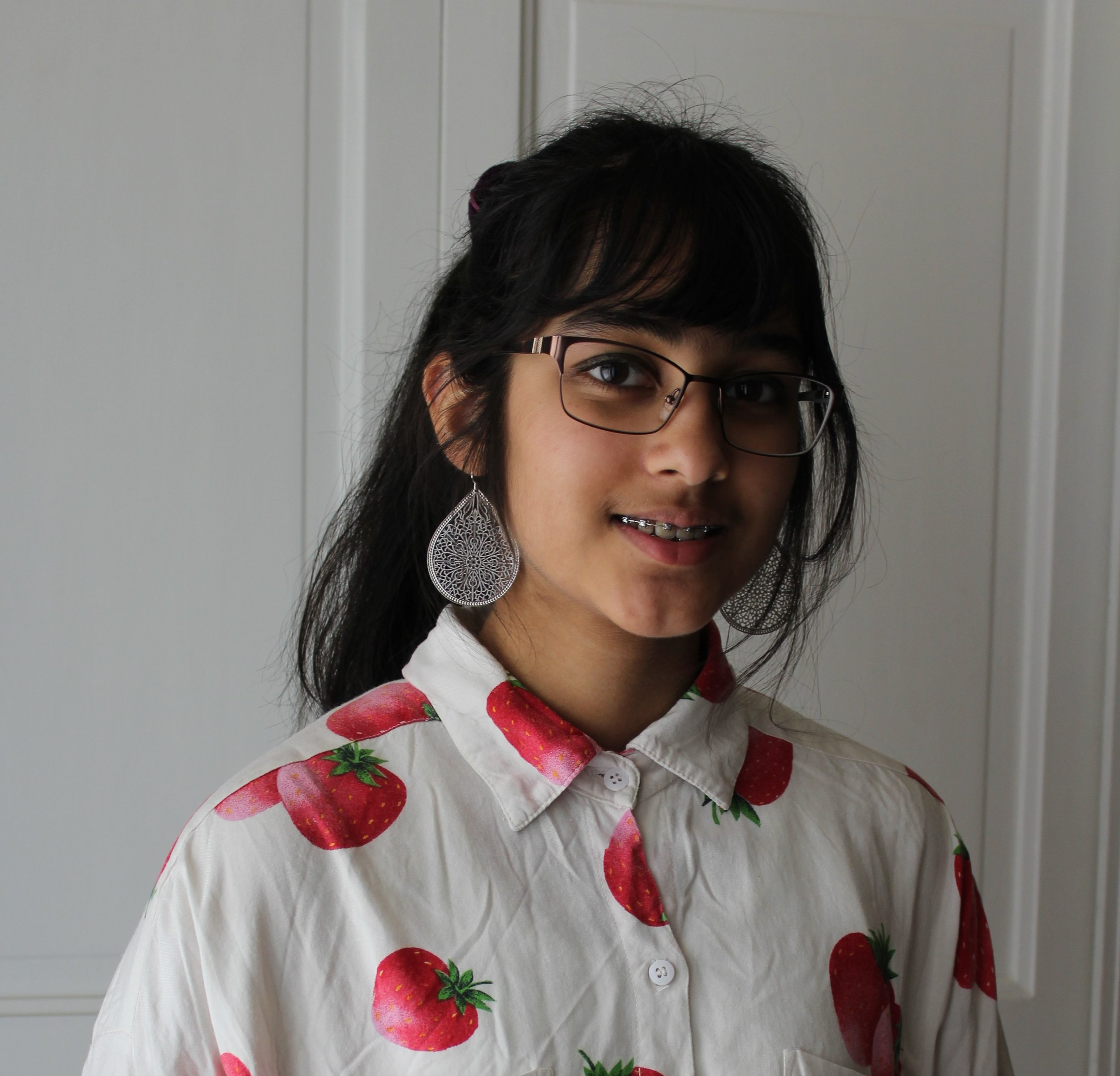 Sandhya Srinivasan - Sandhya Srinivasan is a student and avid writer in Troy, Michigan. She can be found either reading, drawing, listening to music whilst doing a crossword puzzle, or watching movies and television shows. She loves collecting foreign currency, model horses, and hotel key cards, but also stories, to write later.