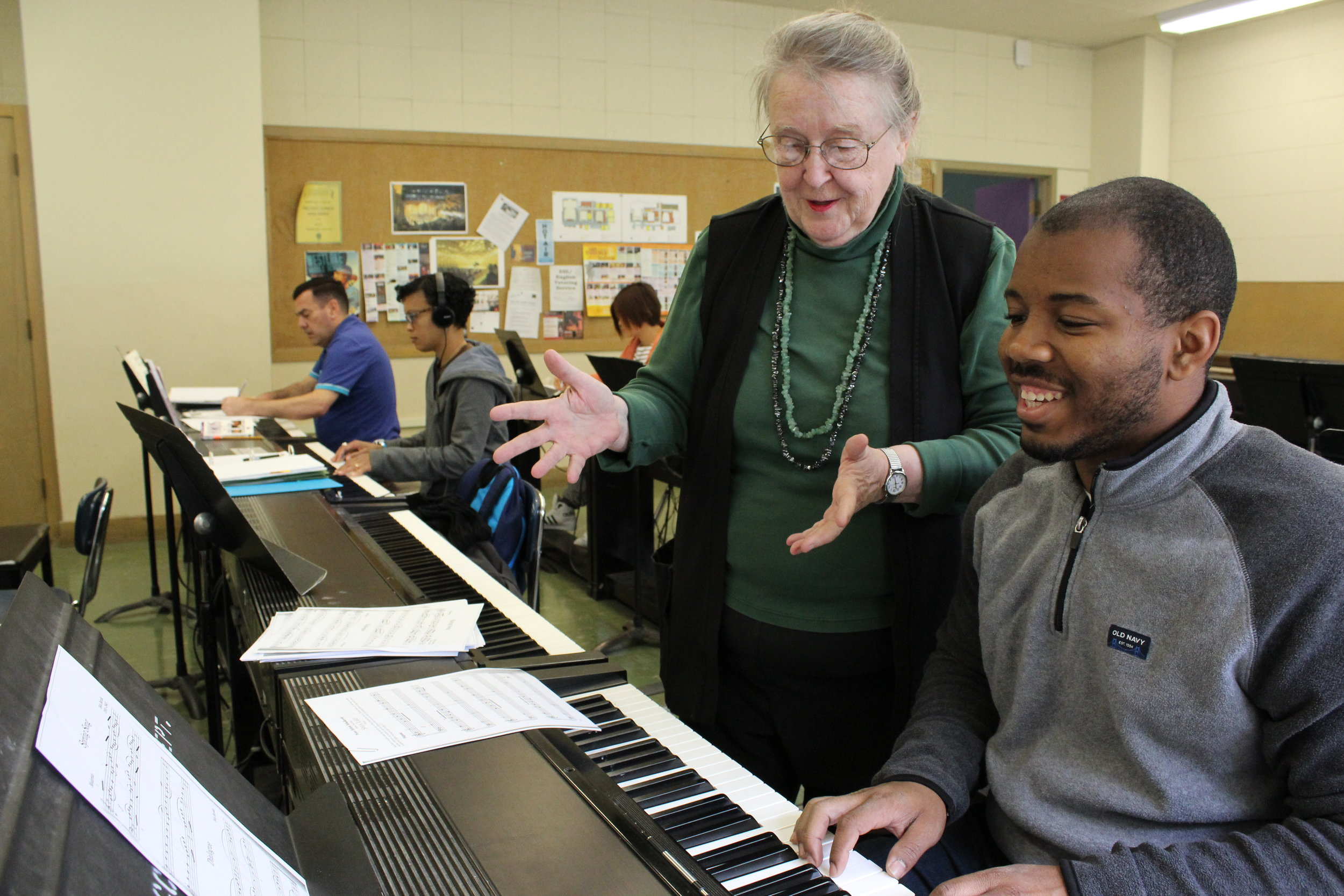 Madeline Mueller instructs a piano student during a lesson. April 2016
