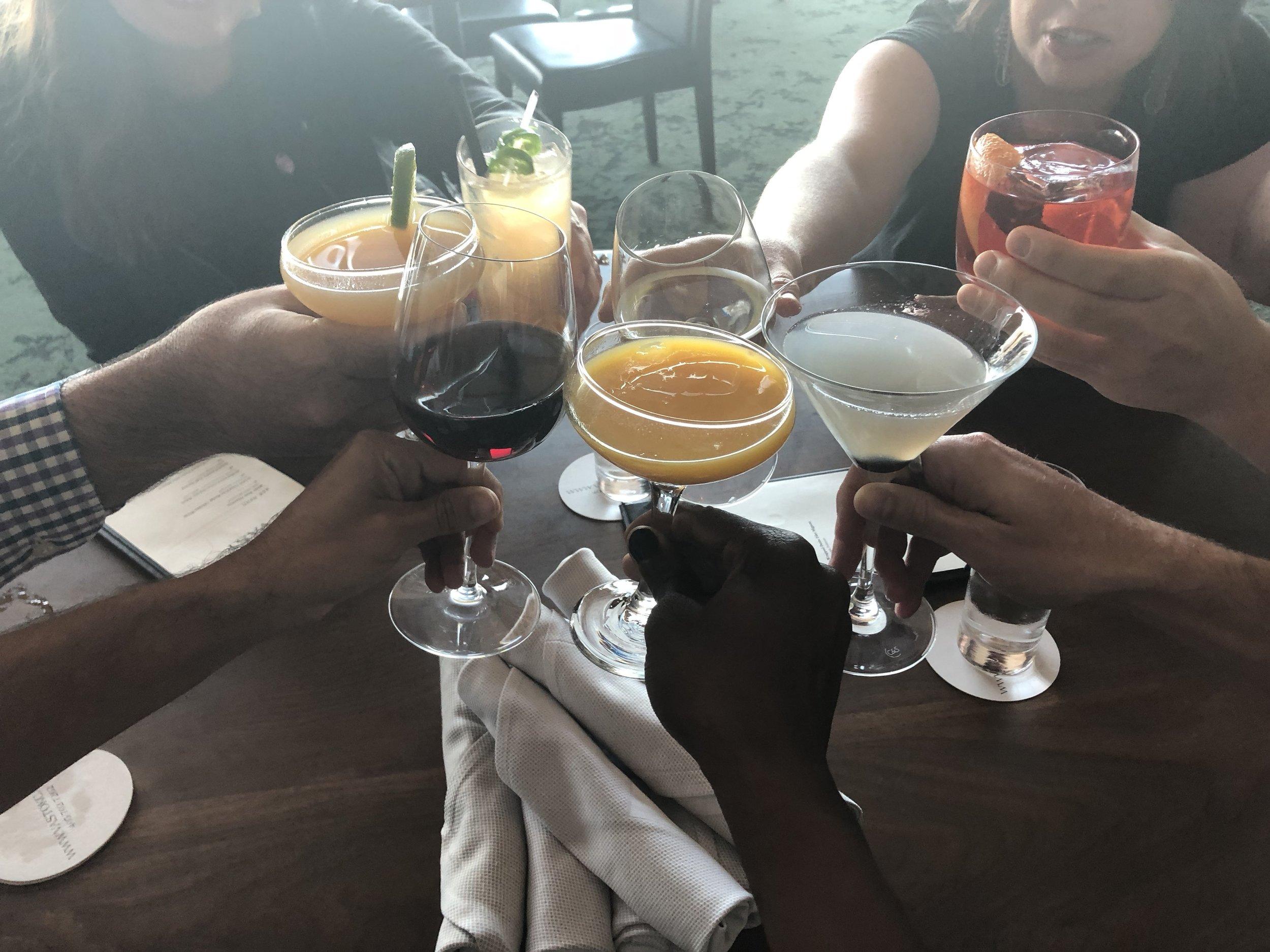 Cheers from Vast, a 49th-floor hotspot inside Devon Tower.