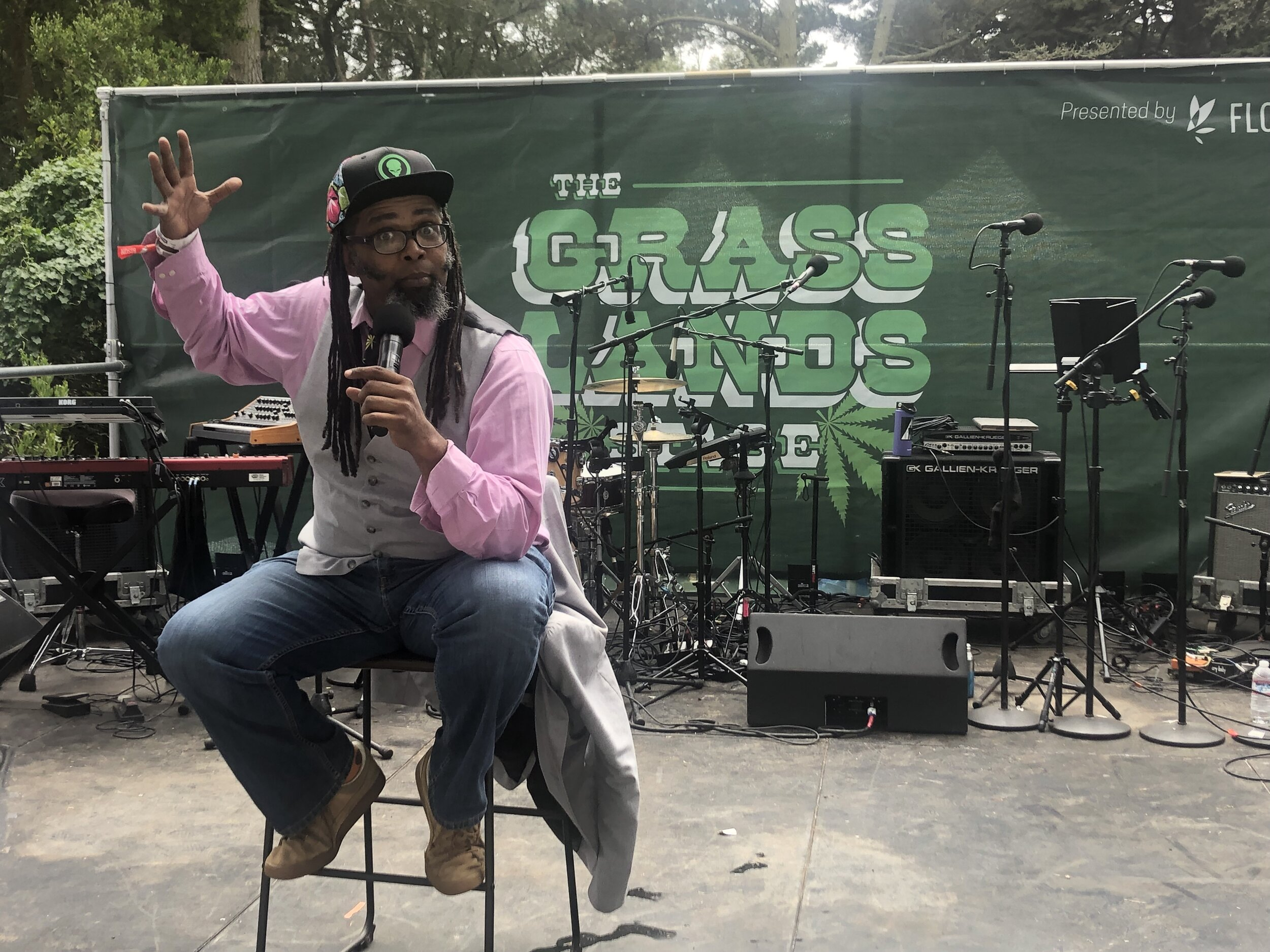 Comedian Ngaio Bealum performing on the Grass Lands Stage.