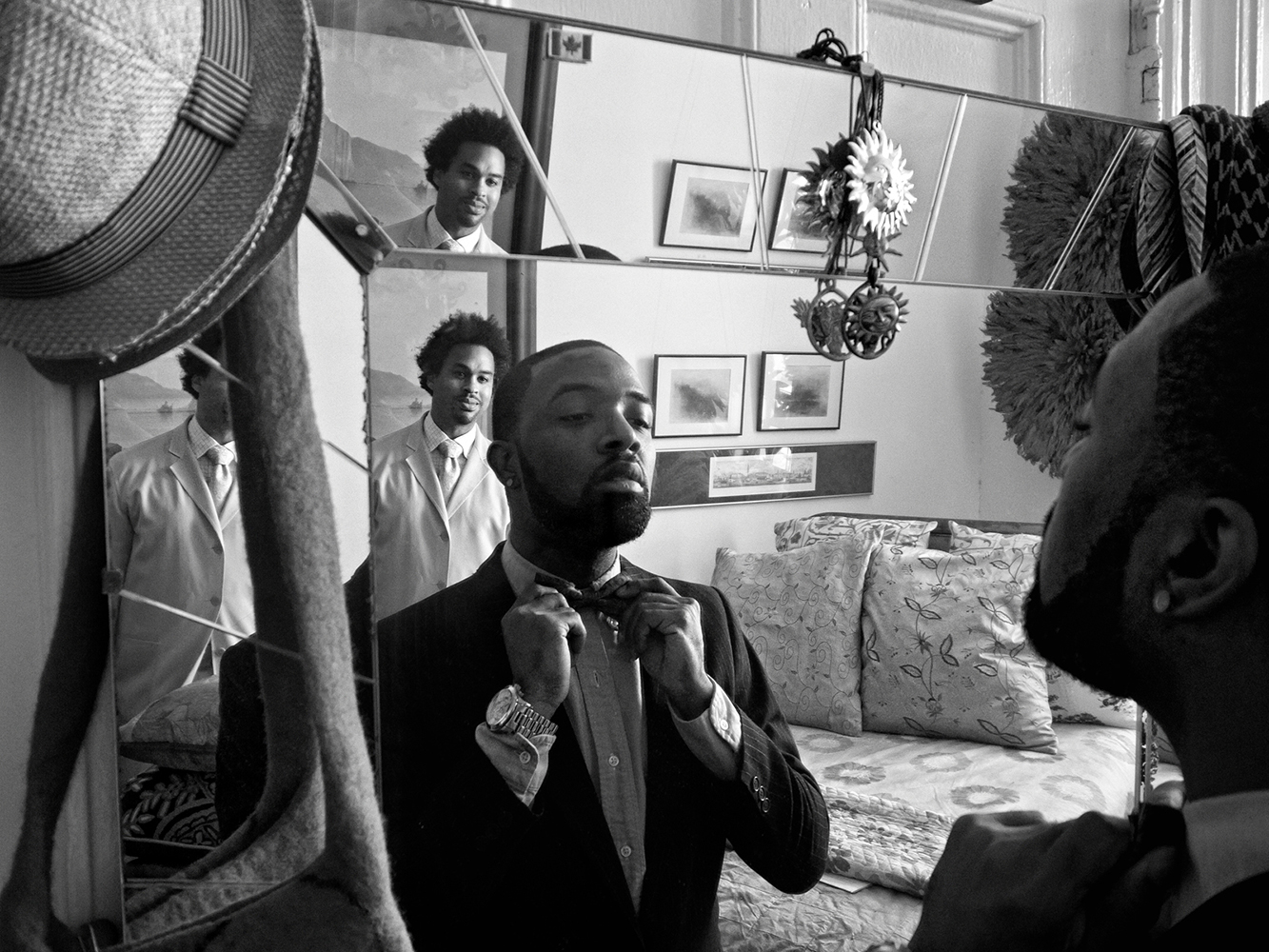 Zun Lee,  Jerome Williams ties his first bow tie, with father James Reynolds observing , Harlem, NY, 2011