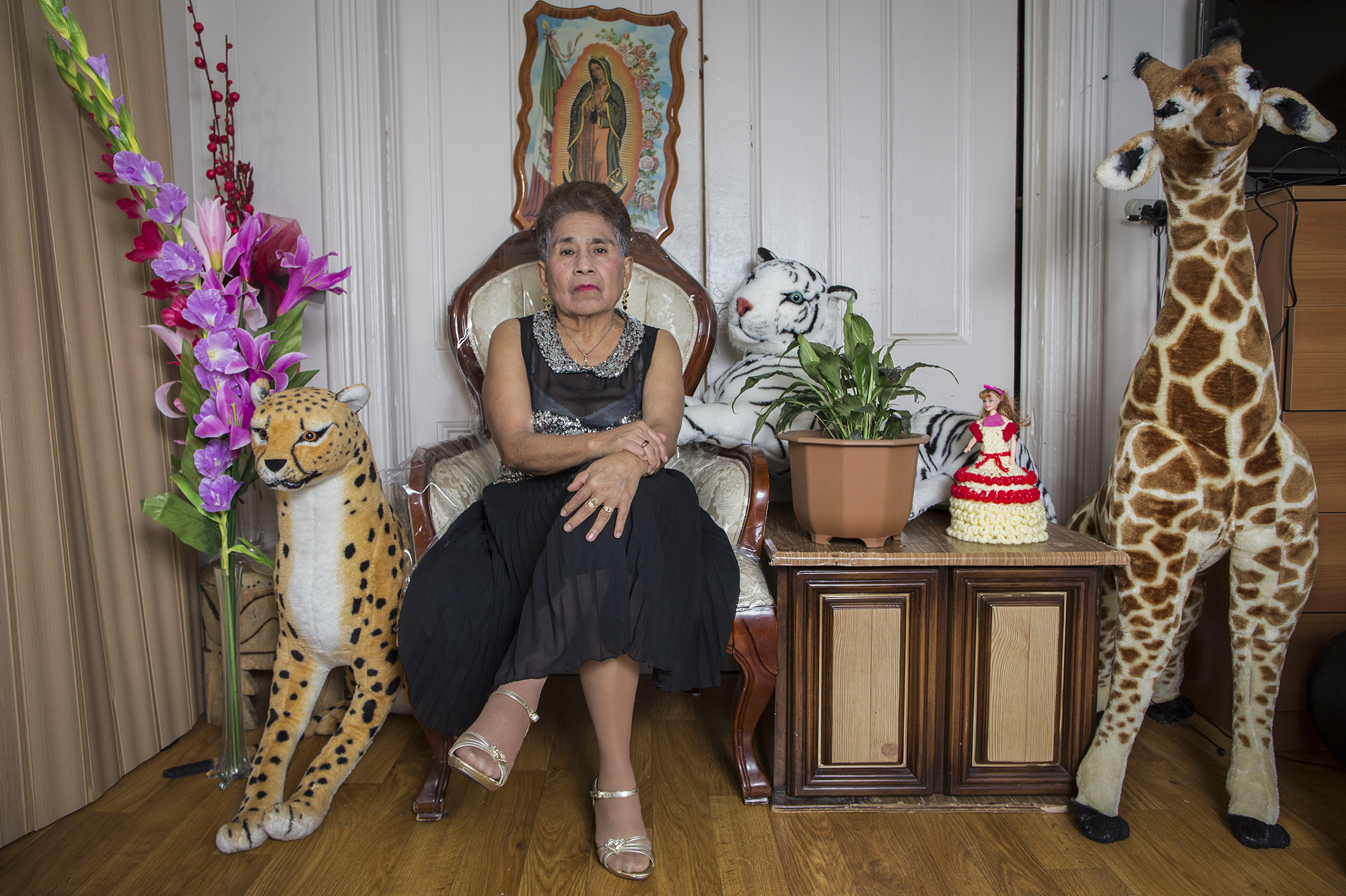 Gisela Bravo Martinez in her apartment at 45th Street in the neighborhood of Sunset Park, Brooklyn, New York. She is from San Bernardino, Acatlán de Osorio, State of Puebla, México. She has been living in New York City for more than two decades working in groceries and factories, though she is a professional seamstress. She is 66 years old and a grandmother of six.