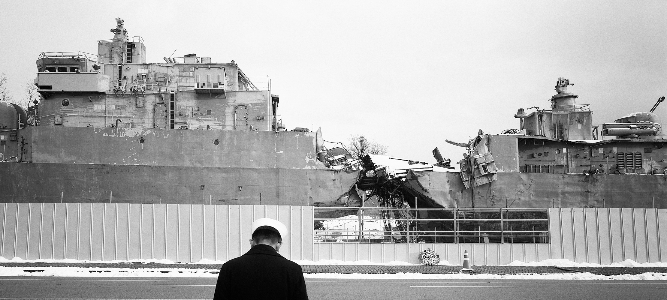 Jinhyun Cha,  Soldier lowering head in front of the torpedoed warship,  2013