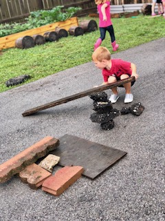 Rainy day = loose parts play! When offered a blank canvas (empty parking lot and no toys), their creative minds thrive!