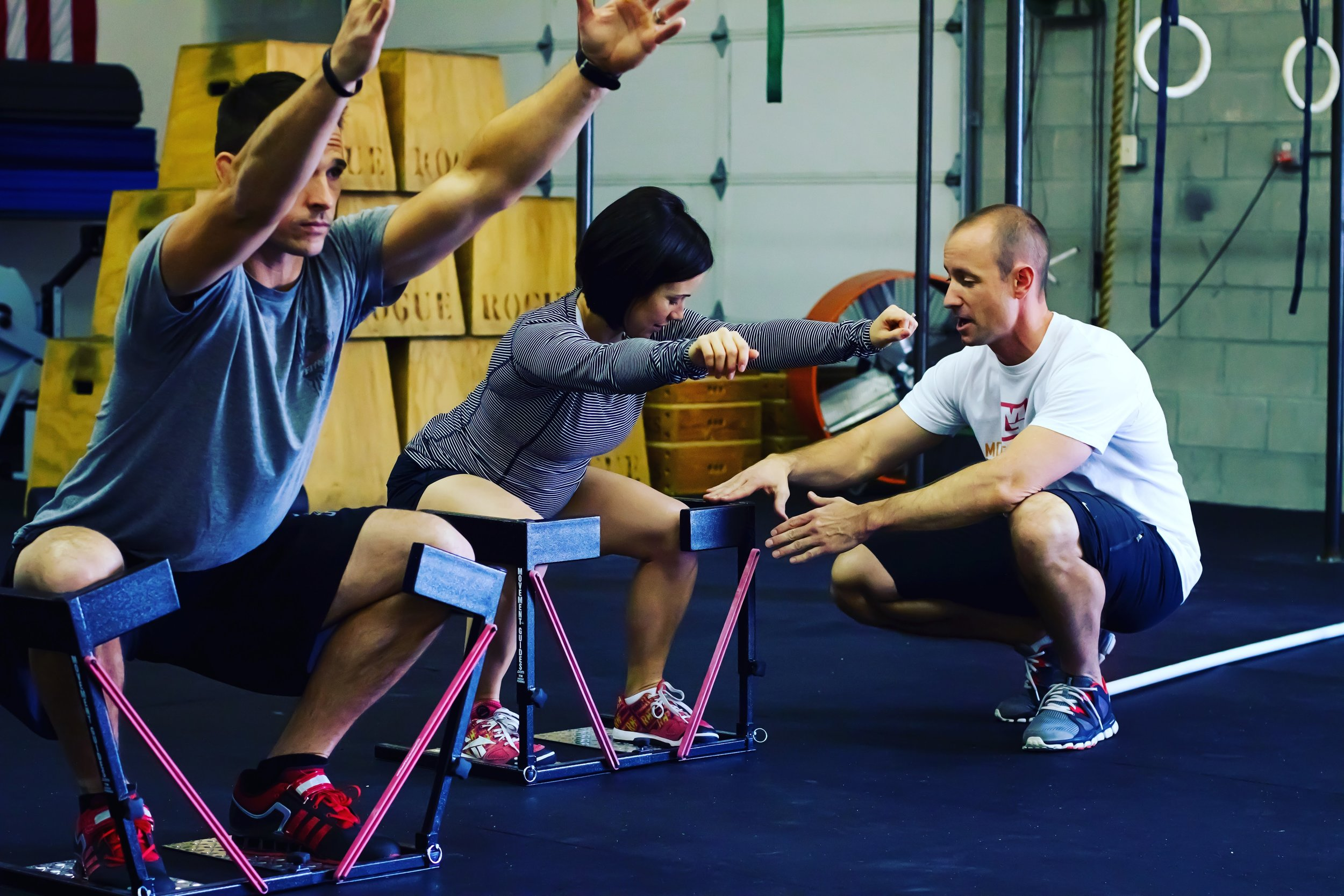 Instructing squat form in the patented SquatGuide from Movement Guides