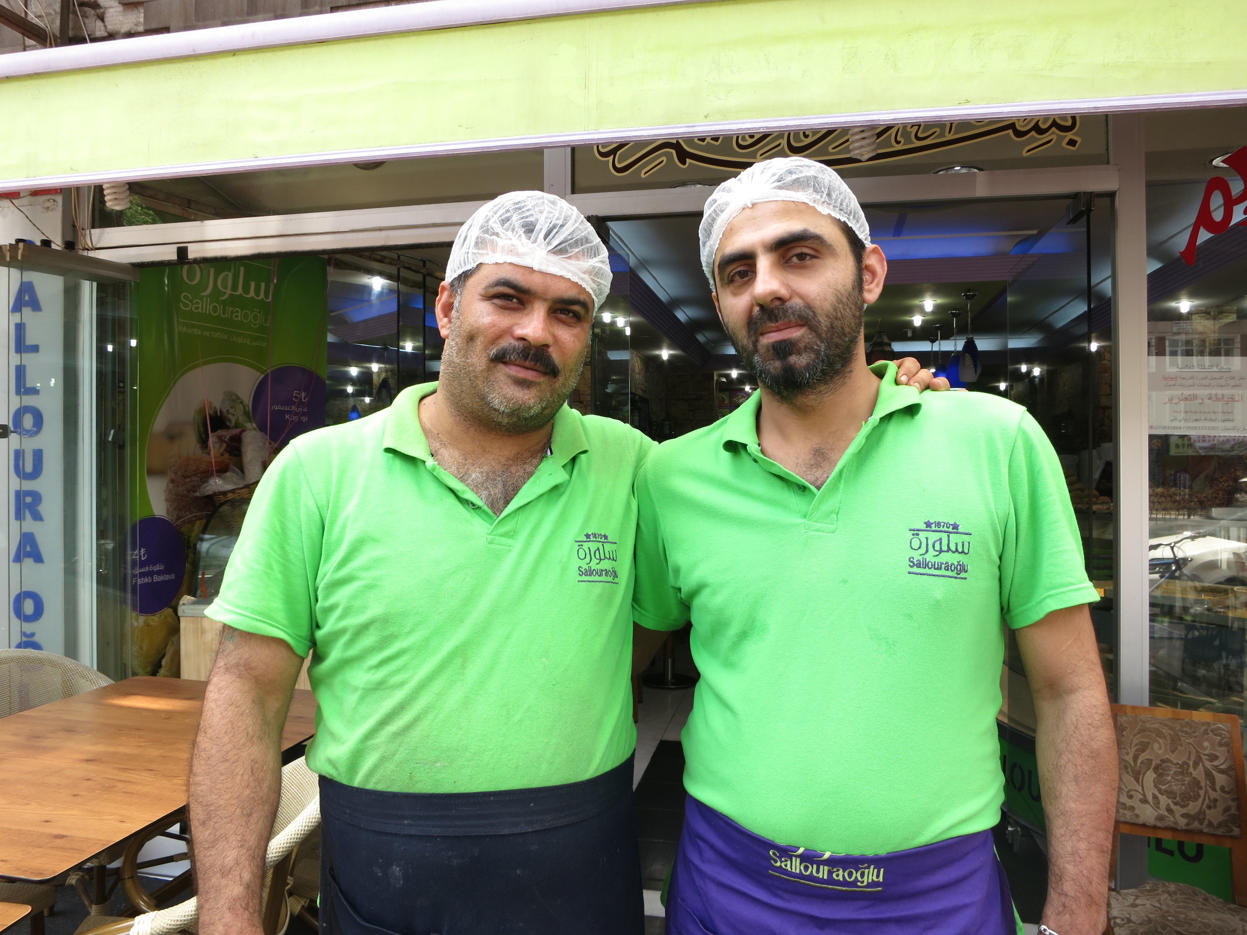 Best friends Ahmed and Rashed stand outside the Salloura shop in Istanbul before the evening rush. (Photo by Dalia Mortada)