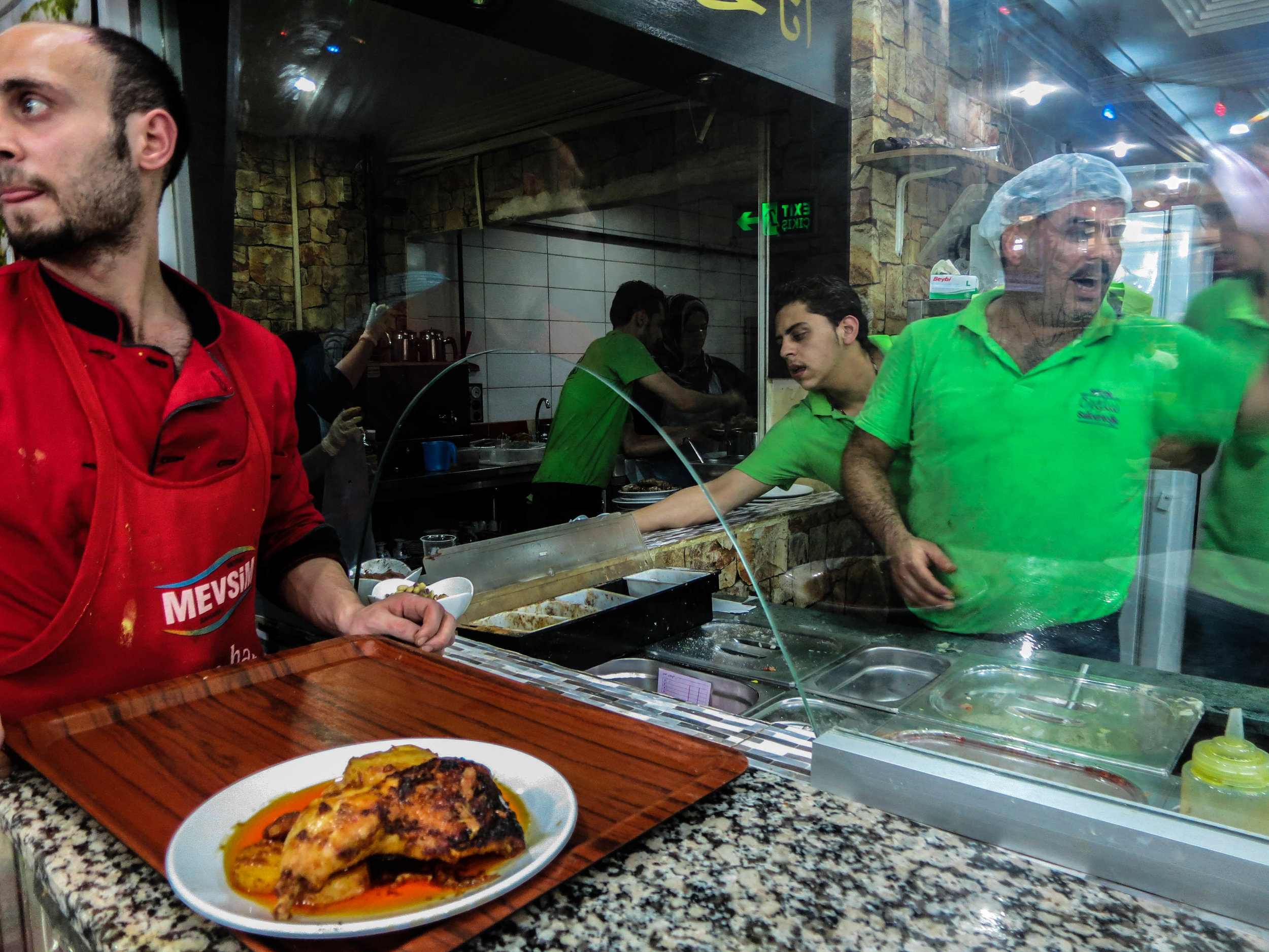 Ahmed Sheikho manages Salloura in Istanbul during the evening rush, calling out order from behind the counter. (Photo by Dalia Mortada)