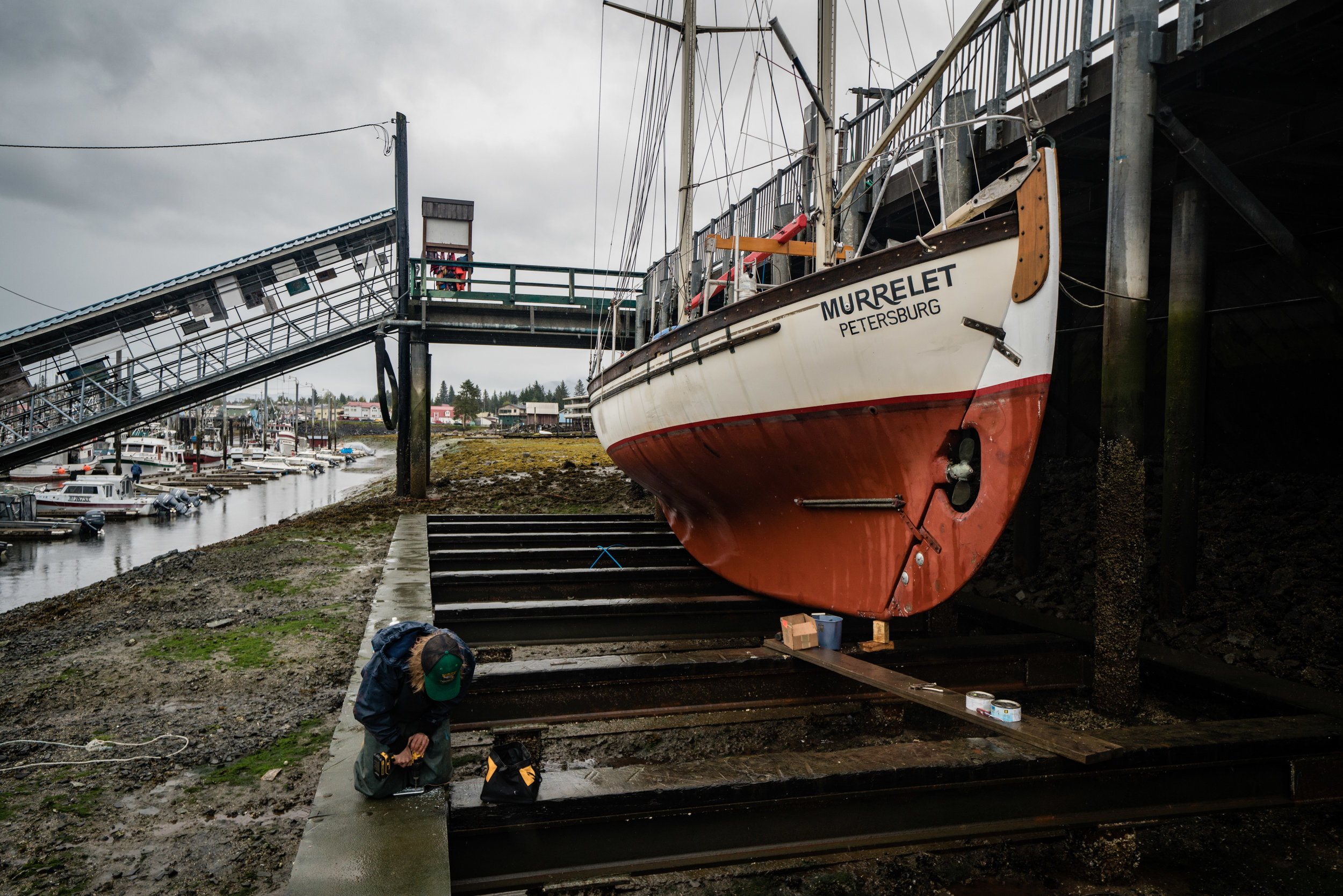 Boat work just days before we embark on our voyage. Photo: Colin Arisman.