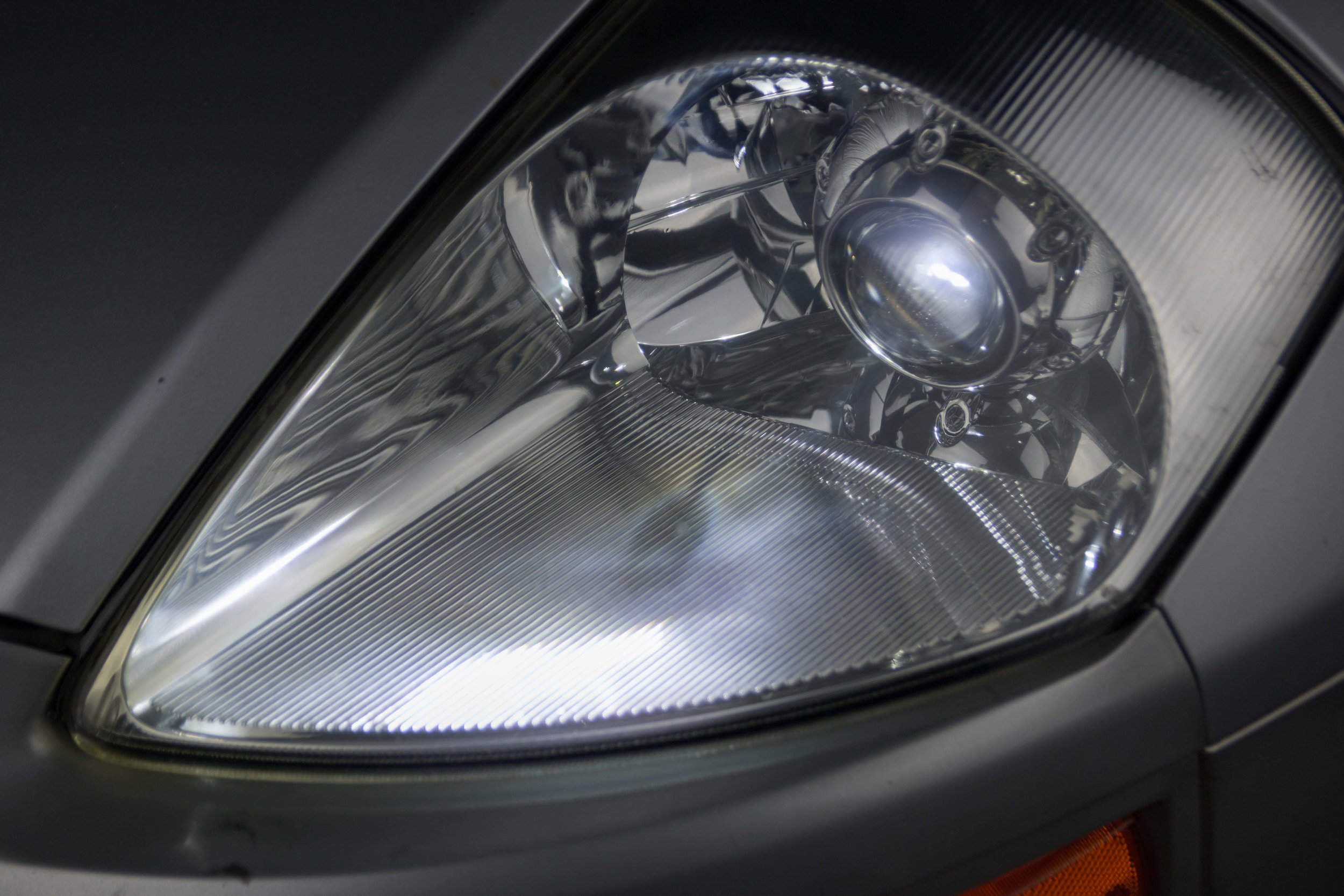 Headlight Restoration - Make your old hazy headlights look like new. A proper restoration will not only freshen up the look of your car but will help more light on the road.