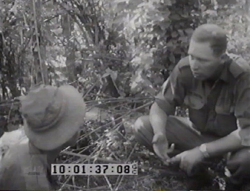 w. Capt MacGregor briefing a Tunnel Rat on Operation Enoggera.jpg
