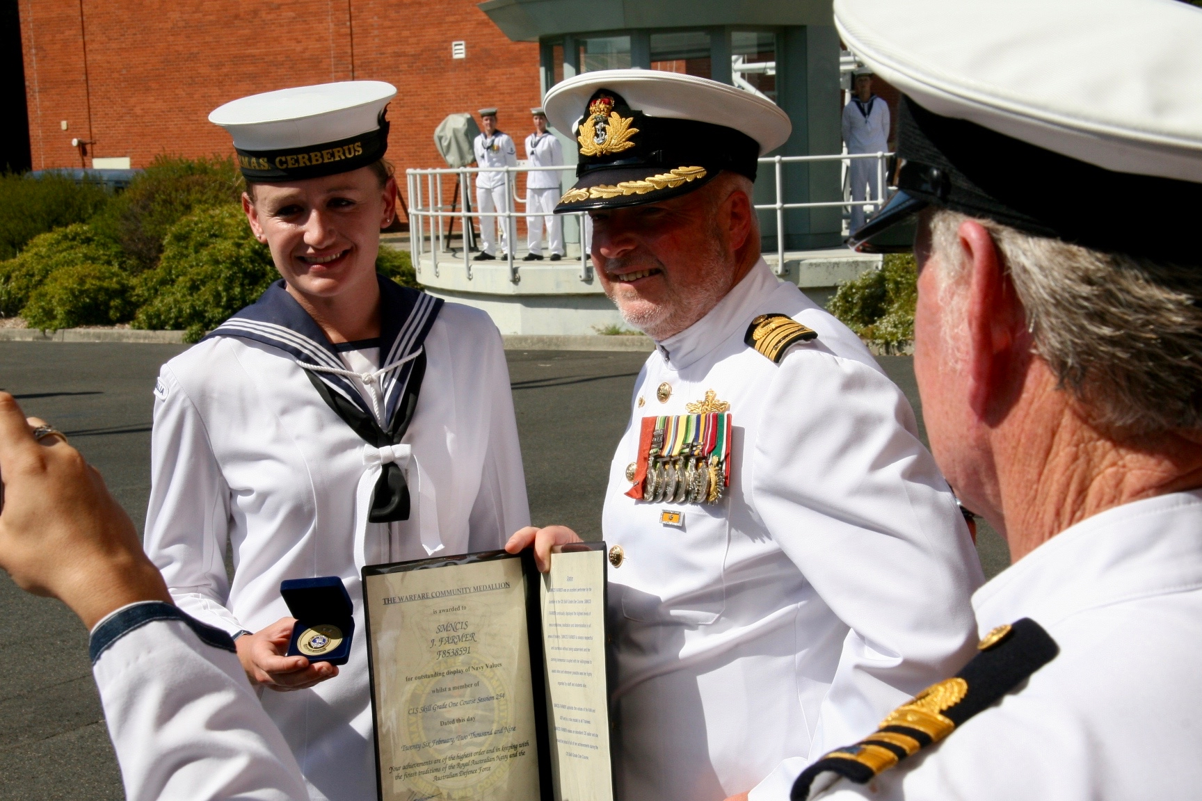 PIC 1      2008 – HMAS CERBERUS – the day I graduated from Communications School (the Commanding Officer of HMAS Cerberus at the time in the photo too presenting me with the Community Warfare Medallion for my class).jpg