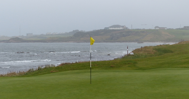 Rollicking Start -- Here's the view from the 1st green looking back toward the clubhouse and across a chilly (but definitely not chill) North Sea.